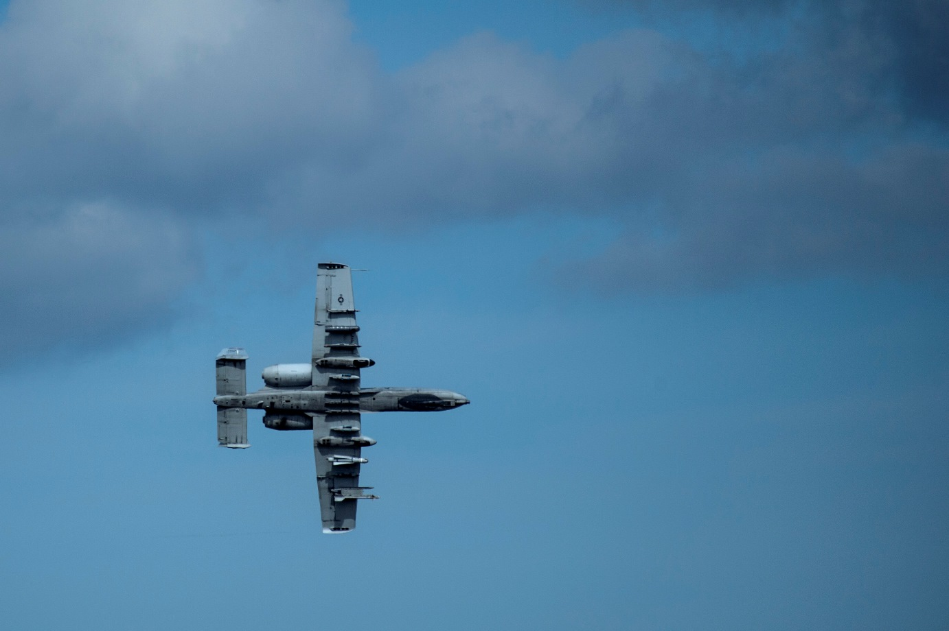 An A-10 Thunderbolt II attack aircraft flies over the airfield at Ämari Air Base, Estonia during Exercise Hedgehog May 7, 2015, . The A-10 supports Air Force missions around the world as part of the U.S. Air Force's current inventory of strike platforms, including the F-15E Strike Eagle and the F-16 Fighting Falcon fighter aircraft. (U.S. Air Force photo by Senior Airman Rusty Frank/Released)