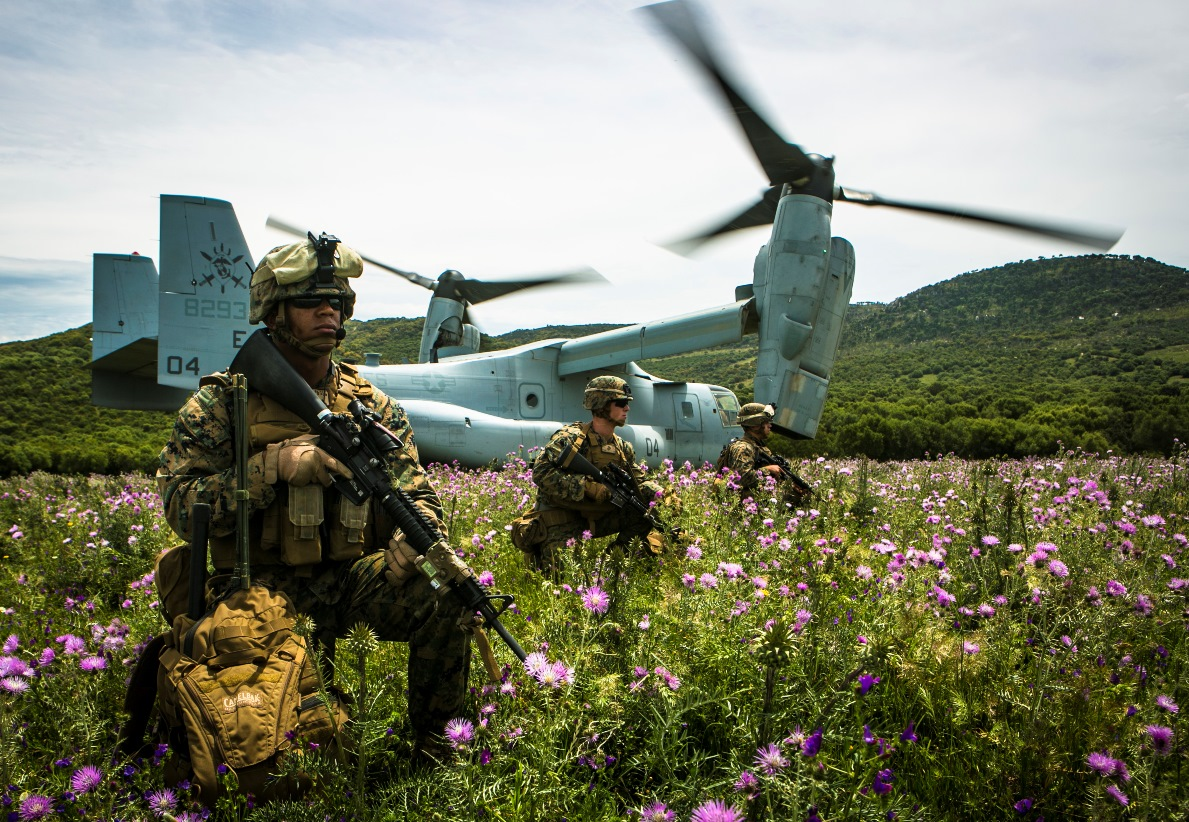 U.S. Marine Lance Cpl. Victor CastilloGarcia, left, a field radio operator from Special-Purpose Marine Air-Ground Task Force Crisis Response-Africa, provides security for an MV-22B Osprey at a landing zone in Sierra Del Retin, Spain, May 4, 2015. The Marines landed at the site to conduct range operations with the Spanish Marines, who used the Osprey as part of their battalion's training exercise. (U.S. Marine Corps photo by Sgt. Paul Peterson/Released)