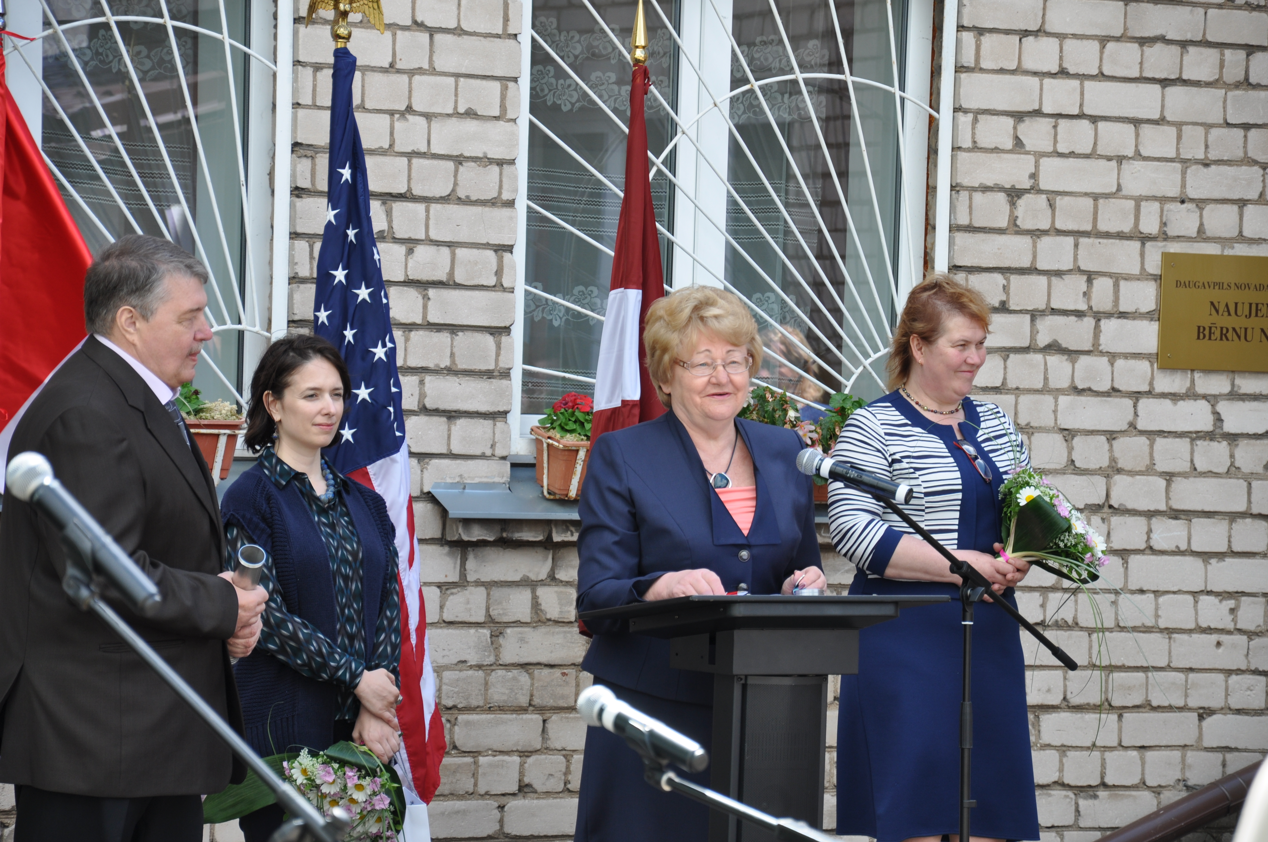 Ms. Vanda Kezika, the Executive Director of the Daugavapils Regional Council addressing the troops at the Kick-off ceremony for Humanitarian Civic Assistance (HCA) Project at Naujene Orphanage, Daugavpils region, Latvia (from left: Mr. Jurij Denisov (SIA Ditton Būve); Ms. Vanessa Acker (US Embassy); Ms. Vanda Kezika (Daugavpils Regional Council), Ms. Lilita Gasjaņeca (Naujene Orphanage). Photo by Office of Defense Cooperation Latvia.