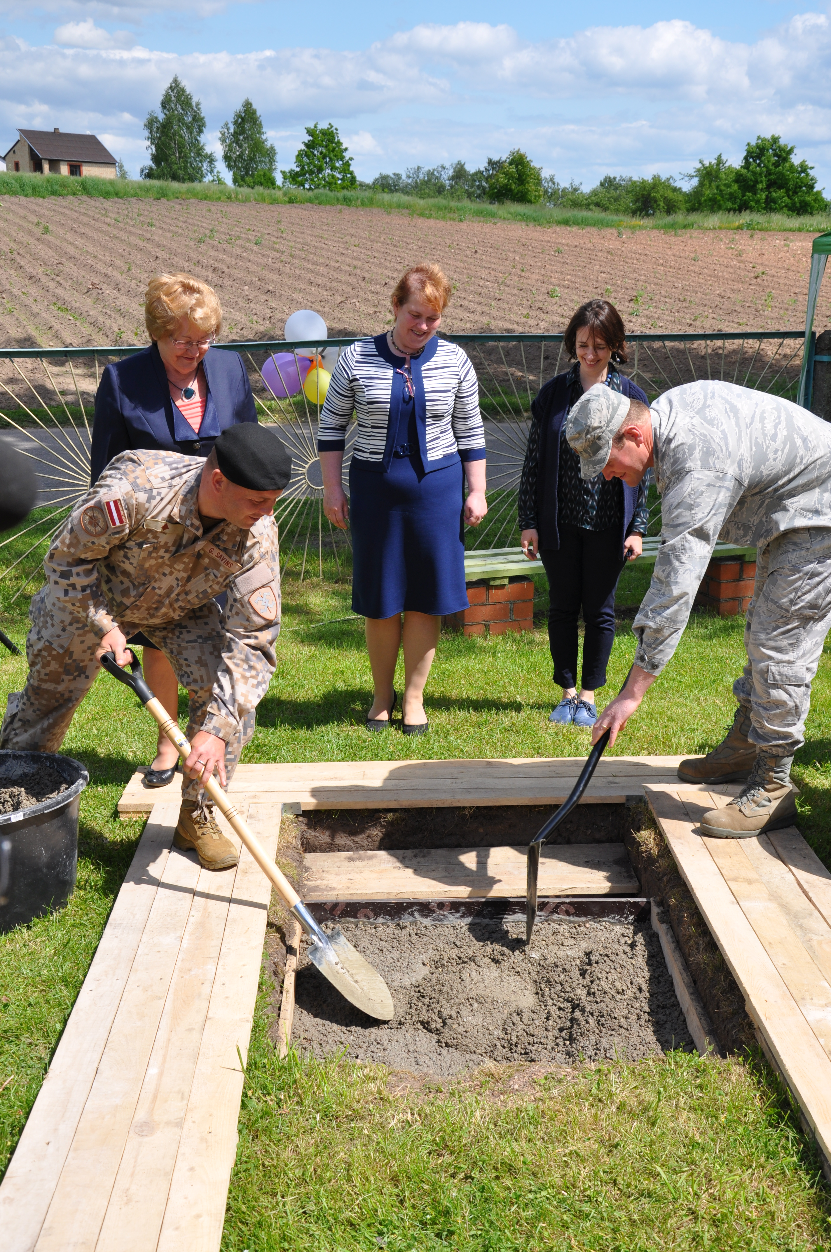 MAJ Girts Savins (Latvian National Armed Forces); Ms. Vanda Kezika (Daugavpils Regional Council), Ms. Lilita Gasjaņeca (Naujene Orphanage), Ms. Vanessa Acker (U.S. Embassy), MAJ Noah Diehl (190th CES, KS ANG) are placing a time capsule to commemorate the start of the renovation project at Naujene Orphanage. Photo by Office of Defense Cooperation Latvia.