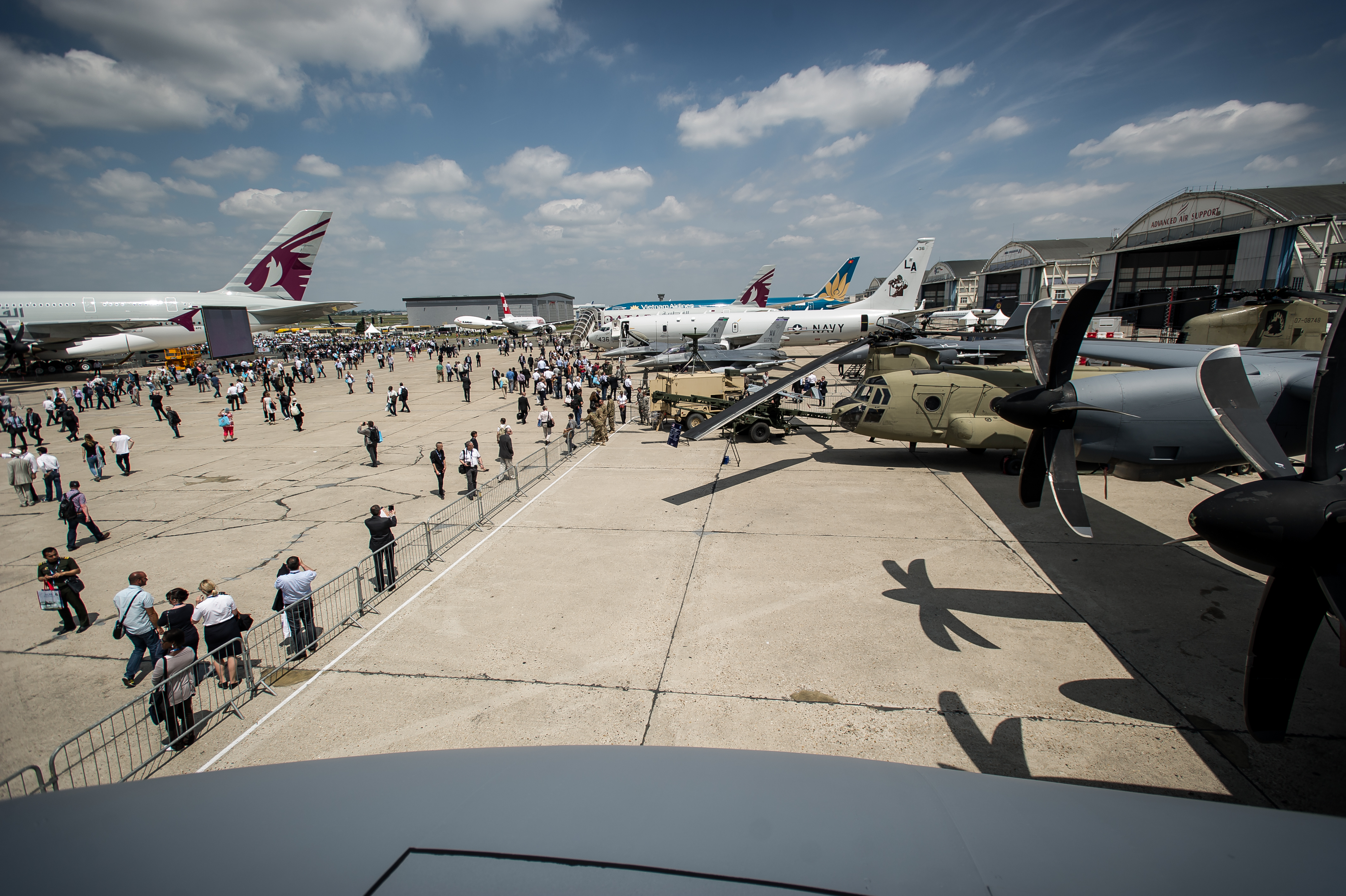 U.S. Army, Navy and Air Force aircraft are on display during the Paris Air Show at Le Bourget Airport, France, June 17, 2015. The Paris Air Show provides a collaborative opportunity to share and strengthen the U.S. and European strategic partnership that has been forged during the last seven decades and is built on a foundation of shared values, experiences and vision. The event is expected to bring in 315,000 people, a record 2,215 companies, 150 aircraft, and will span 324,000 square meters. (U.S. Air Force photo/ Tech. Sgt. Ryan Crane)