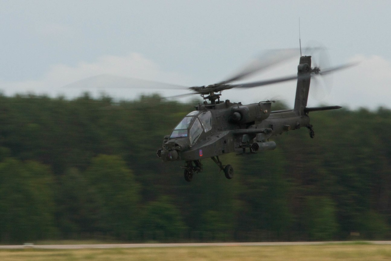 Soldiers with the 2nd Battalion, 159th Attack Reconnaissance Battalion, 12th Combat Aviation Brigade take off in a Boeing AH-64 Apache helicopter June 18, 2015, in Mirosławiec, Poland, during Saber Strike 15. Encompassing more than 6,000 participants from 13 different nations, Saber Strike is a long-standing U.S. Army Europe-led cooperative training exercise. Designed to improve joint operational capability in a range of missions as well as preparing the participating nations and units to support multinational contingency operations, this year's exercise takes place across Estonia, Latvia, Lithuania and Poland. (U.S. Army photo by Spc. Marcus Floyd, 13th Public Affairs Detachment)