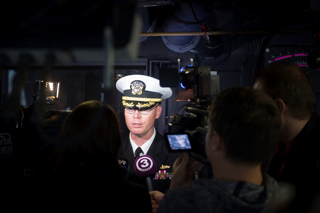 Cmdr. Darren Dugan, commanding officer, USS Jason Dunham (DDG 109) conducts an on-camera interview with Estonian media July 8, 2015. Jason Dunham, an Arleigh Burke-class guided-missile destroyer homeported in Norfolk, is conducting naval operations in the U.S. 6th Fleet area of operations in support of U.S. national security interests in Europe. (U.S. Navy photo by Mass Communication Specialist 3rd Class Weston Jones/Released)