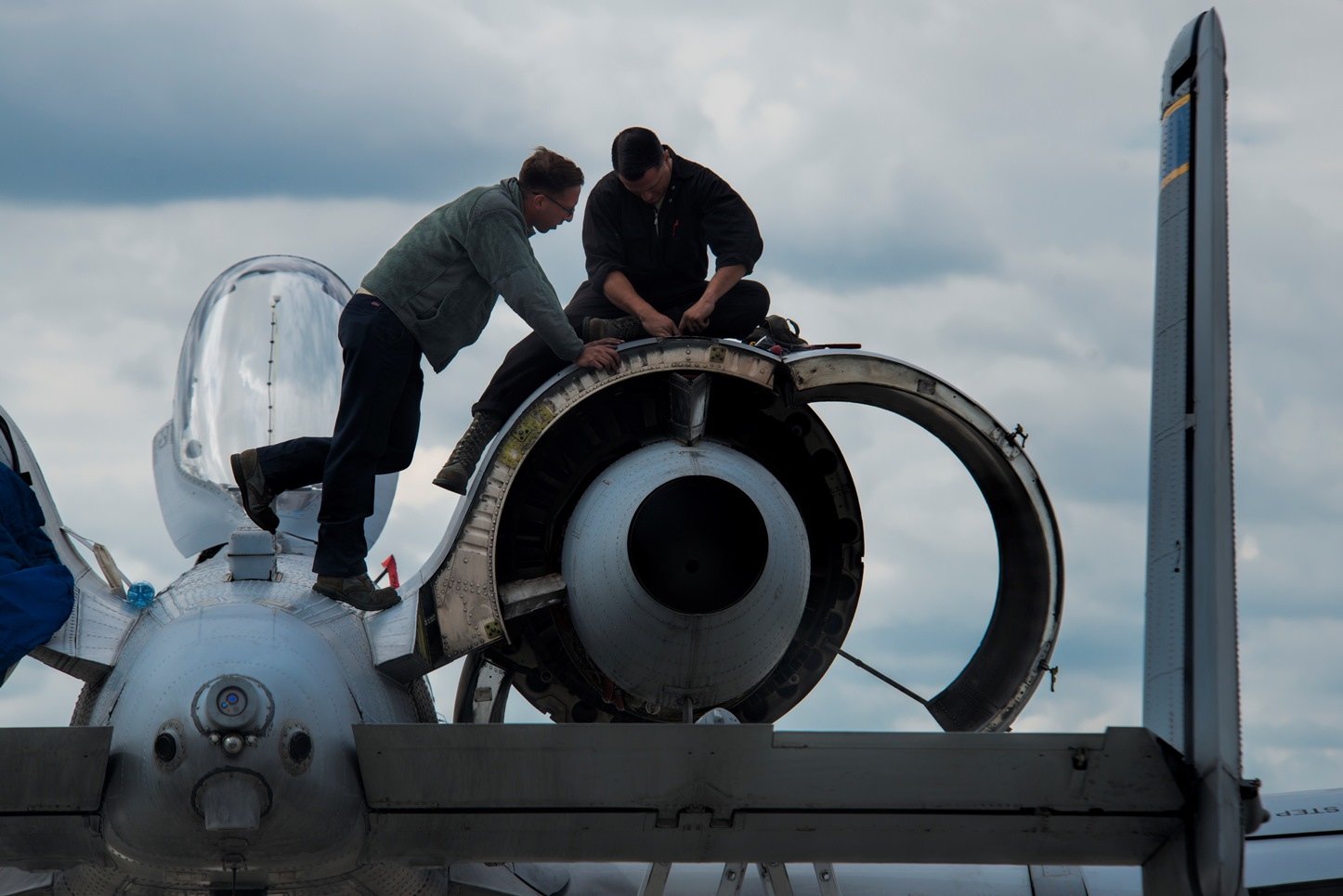 U.S. Air Force crew chiefs from the 354th Expeditionary Fighter Squadron perform maintenance on a U.S. Air Force A-10 Thunderbolt II attack aircraft engine during a theater security package deployment to Lask Air Base, Poland, July 9, 2015. The U.S. and Polish air forces will conduct training aimed to strengthen interoperability and demonstrate the countries' shared commitment to the security and stability of Europe. (U.S. Air Force photo by Staff Sgt. Christopher Ruano/Released)