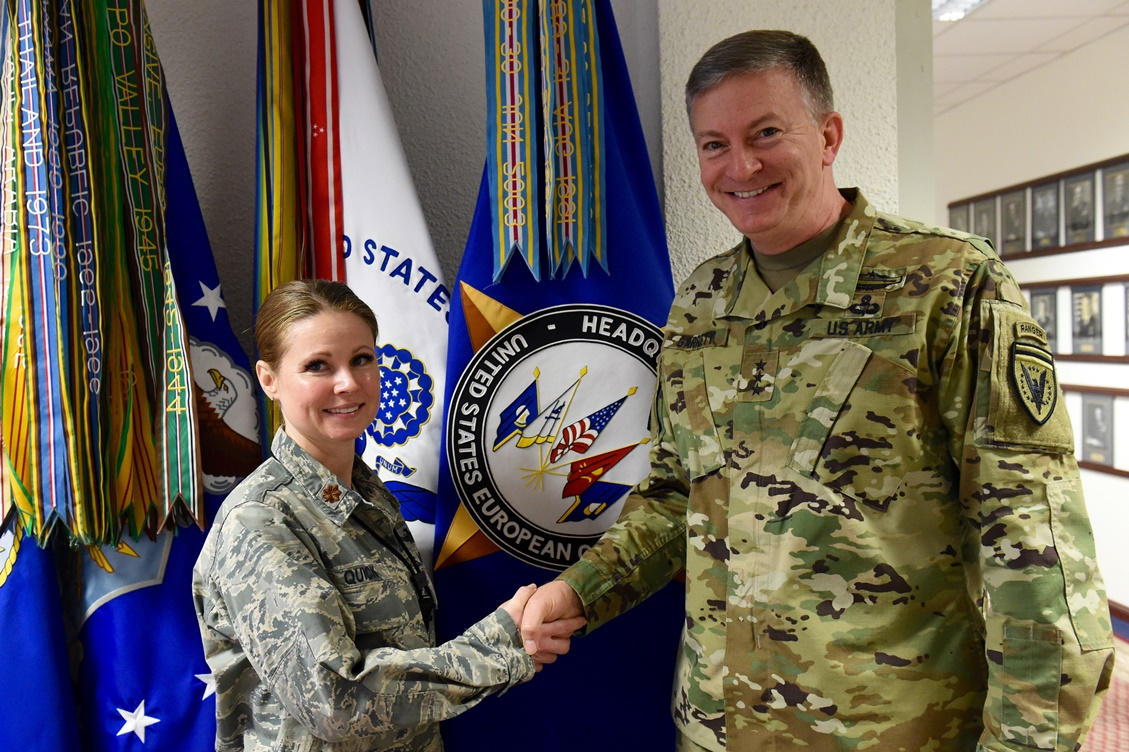 U.S. European Command Deputy Commander Lt. Gen. W. Burke Garrett III presents a coin to Maj. Wendy Quick, Chief of Special Activities Operations Center, for outstanding duty performance Apr. 15, 2016.