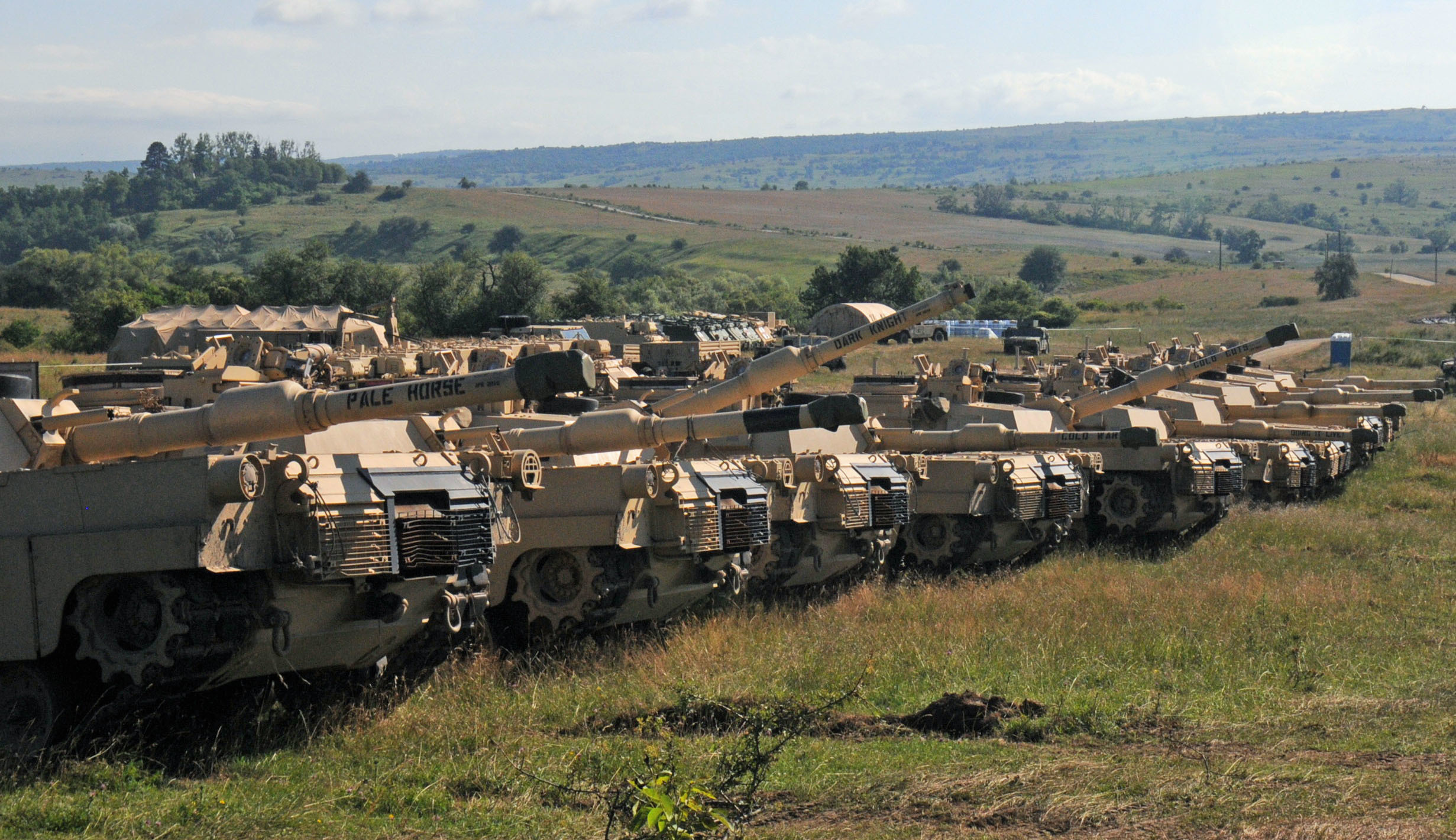 CINCU, Romania – Tanks belonging to the 116th Cavalry Brigade Combat Team (CBCT), Idaho Army National Guard are positioned at the Romanian Land Force Combat Training Center (RLF-CTC) in Cincu, July 7, 2016 prior to the start of Exercise Saber Guardian 2016. The vehicles arrived in Romania on June 19 at the Port of Constanta and were shipped via railhead to Cincu. Saber Guardian is a U.S. Army Europe-led exercise, in the spirit of Partnership for Peace. It is designed to promote regional stability and security, while strengthening partnership capacity, and fostering trust while improving interoperability between Romania, the U.S., NATO and Partnership for Peace member nations. The 116th CBCT is one of the U.S. units participating in the exercise, which will also include forces from 11 different countries.