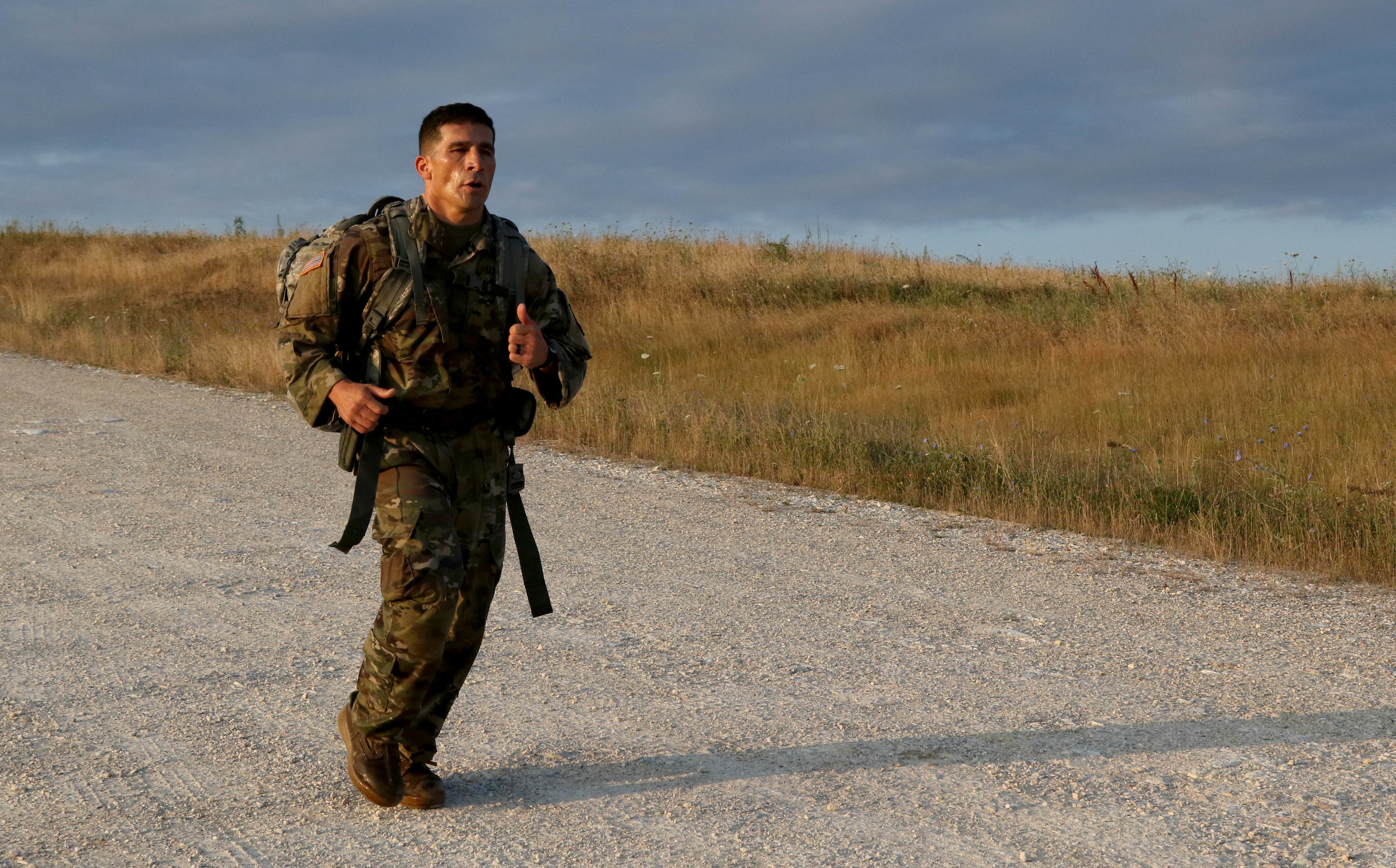 Staff Sgt. Oscar Morales, an infantryman and Arizona Army National Guardsman assigned to the 2nd Assault Helicopter Battalion, 285th Aviation Regiment, conducts a 12-mile ruck march on Camp Bondsteel, Kosovo, during the Multinational Battle Group-East's Best Warrior Competition July 10. (U.S. Army photo by: Staff Sgt. Thomas Duval, Multinational Battle Group-East Public Affairs)