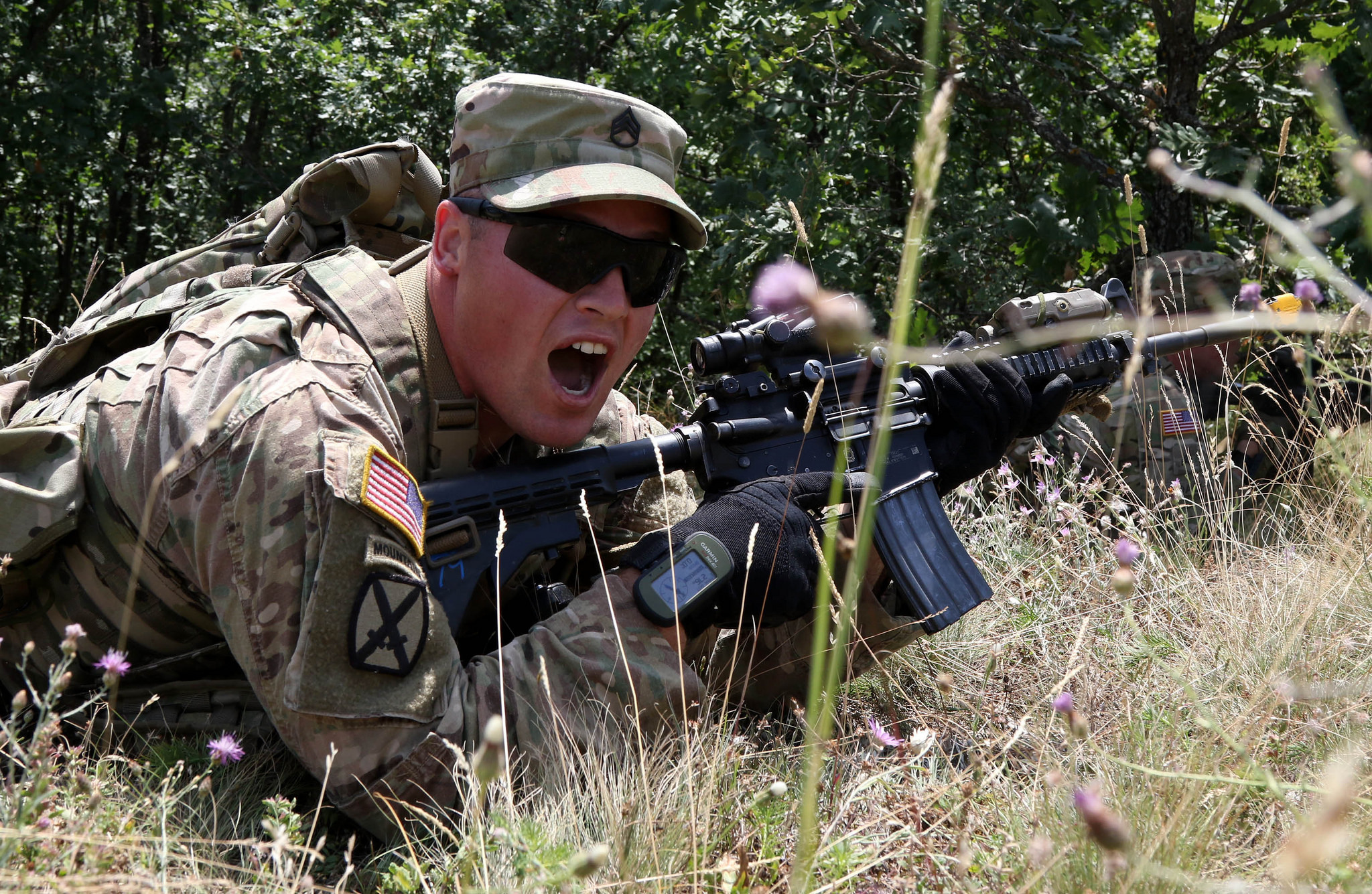 Staff Sgt. Daniel Dalton, squad leader with the 1st Battalion, 41st Infantry Regiment, 2nd Infantry Brigade Combat Team, shouts directions to his team during a squad level situational training exercise held in Dumnice, Kosovo, July 25, 2016. The purpose of the exercise was to train individual squad movements in preparation for a larger scale operation deemed Iron Eagle, later this year. (U.S. Army photo by: Staff Sgt. Thomas Duval, Multinational Battle Group-East Public Affairs)
