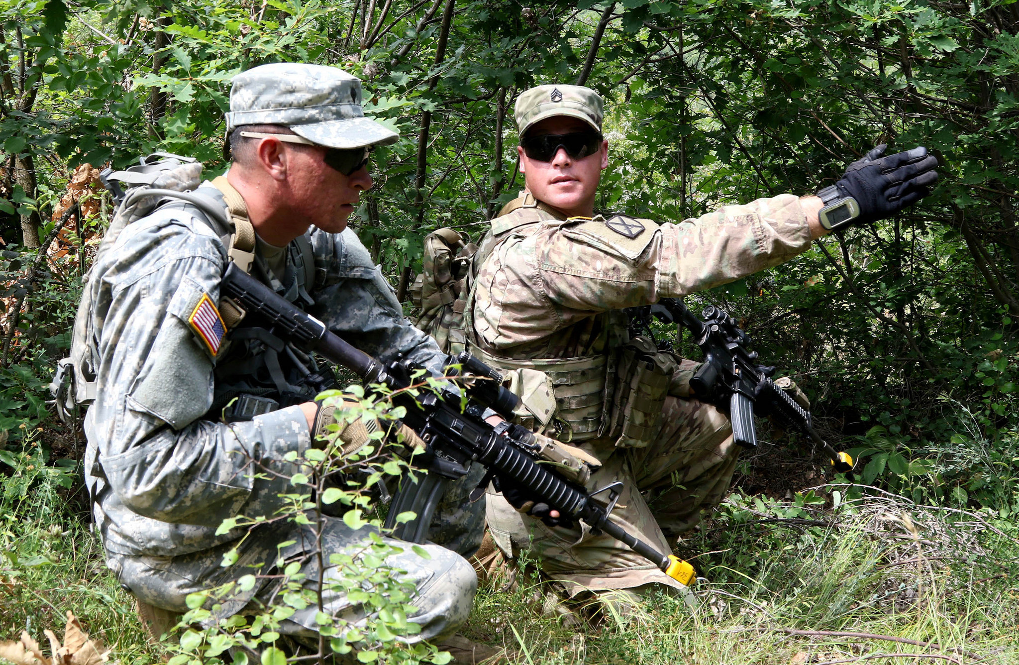 Staff Sgt. Daniel Dalton, squad leader with the 1st Battalion, 41st Infantry Regiment, 2nd Infantry Brigade Combat Team, assigns security positions to his team during a squad-level situational training exercise held in Dumnice, Kosovo, July 25, 2016. The purpose of the exercise was to train individual squad movements in preparation for a larger scale operation deemed Iron Eagle, later this year. (U.S. Army photo by: Staff Sgt. Thomas Duval, Multinational Battle Group-East Public Affairs)