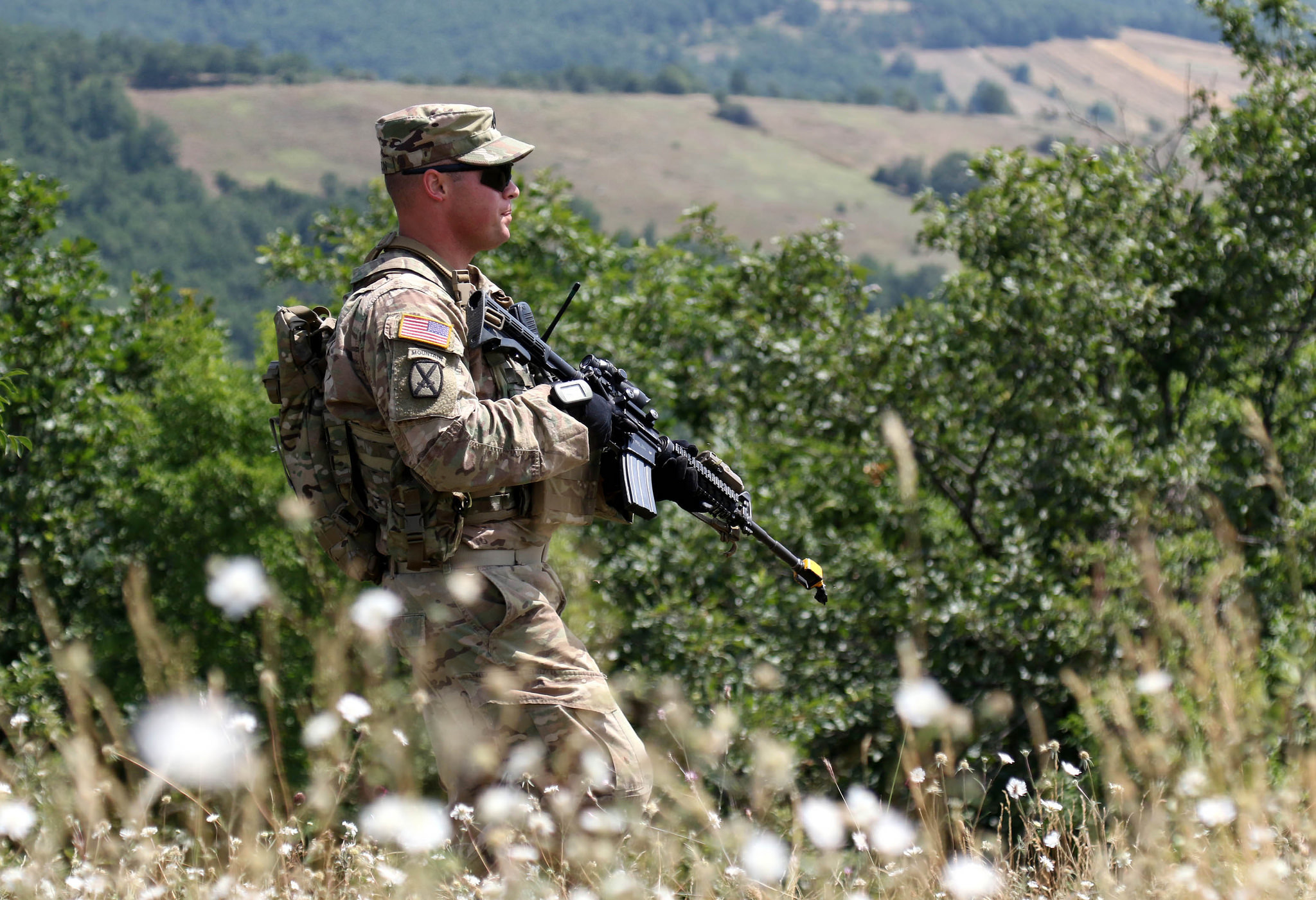 Staff Sgt. Daniel Dalton, squad leader with the 1st Battalion, 41st Infantry Regiment, 2nd Infantry Brigade Combat Team, patrols a ridge line during a squad-level situational training exercise held in Dumnice, Kosovo, July 25, 2016. The purpose of the exercise was to train individual squad movements in preparation for a larger scale operation deemed Iron Eagle, later this year. (U.S. Army photo by: Staff Sgt. Thomas Duval, Multinational Battle Group-East Public Affairs)