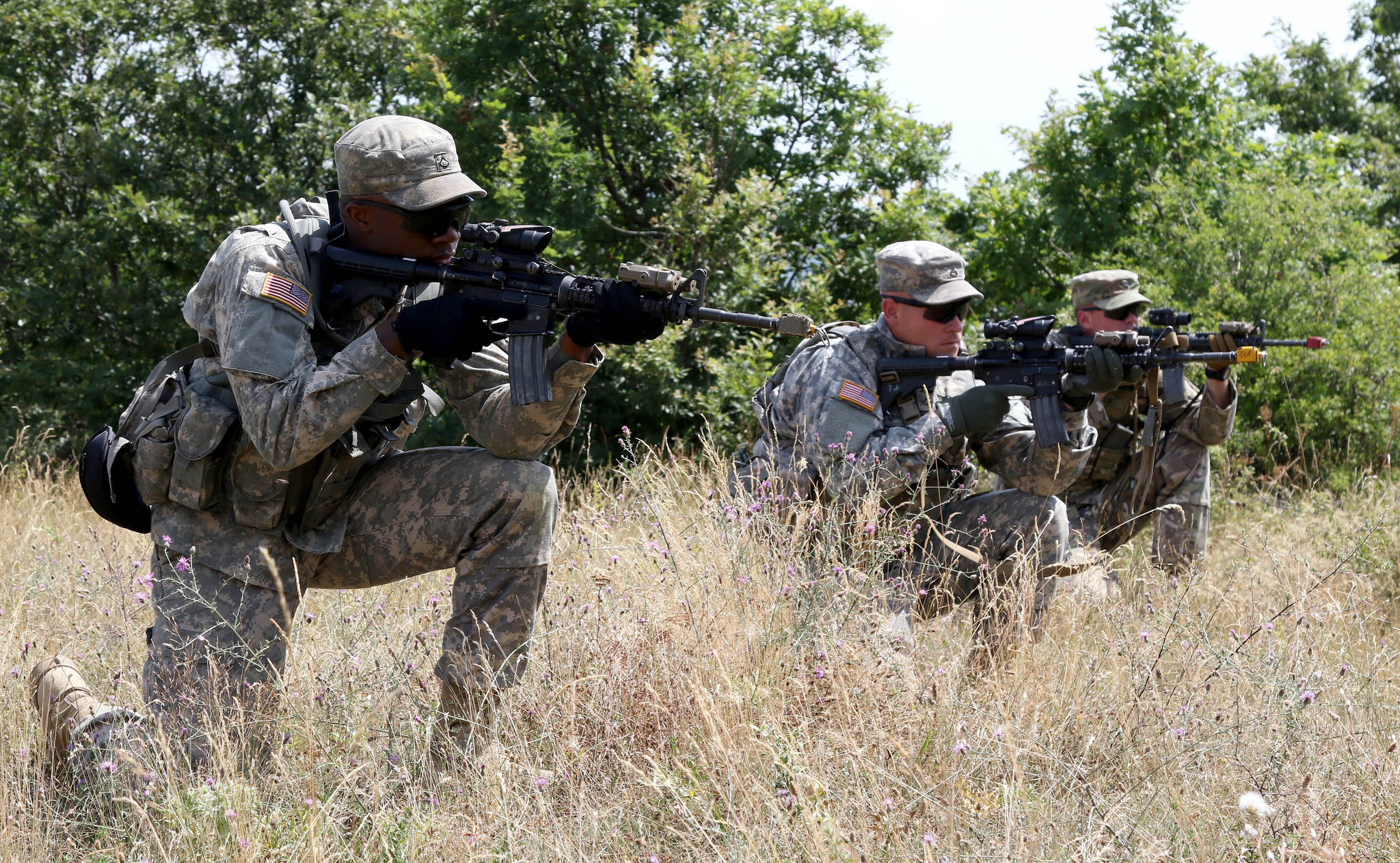 Soldiers from the 1st Battalion, 41st Infantry Regiment, 2nd Infantry Brigade Combat Team, get on line and engage an enemy target during a squad-level situational training exercise held in Dumnice, Kosovo, July 25, 2016. The purpose of the exercise was to train individual squad movements in preparation for a larger scale operation deemed Iron Eagle, later this year. (U.S. Army photo by: Staff Sgt. Thomas Duval, Multinational Battle Group-East Public Affairs)