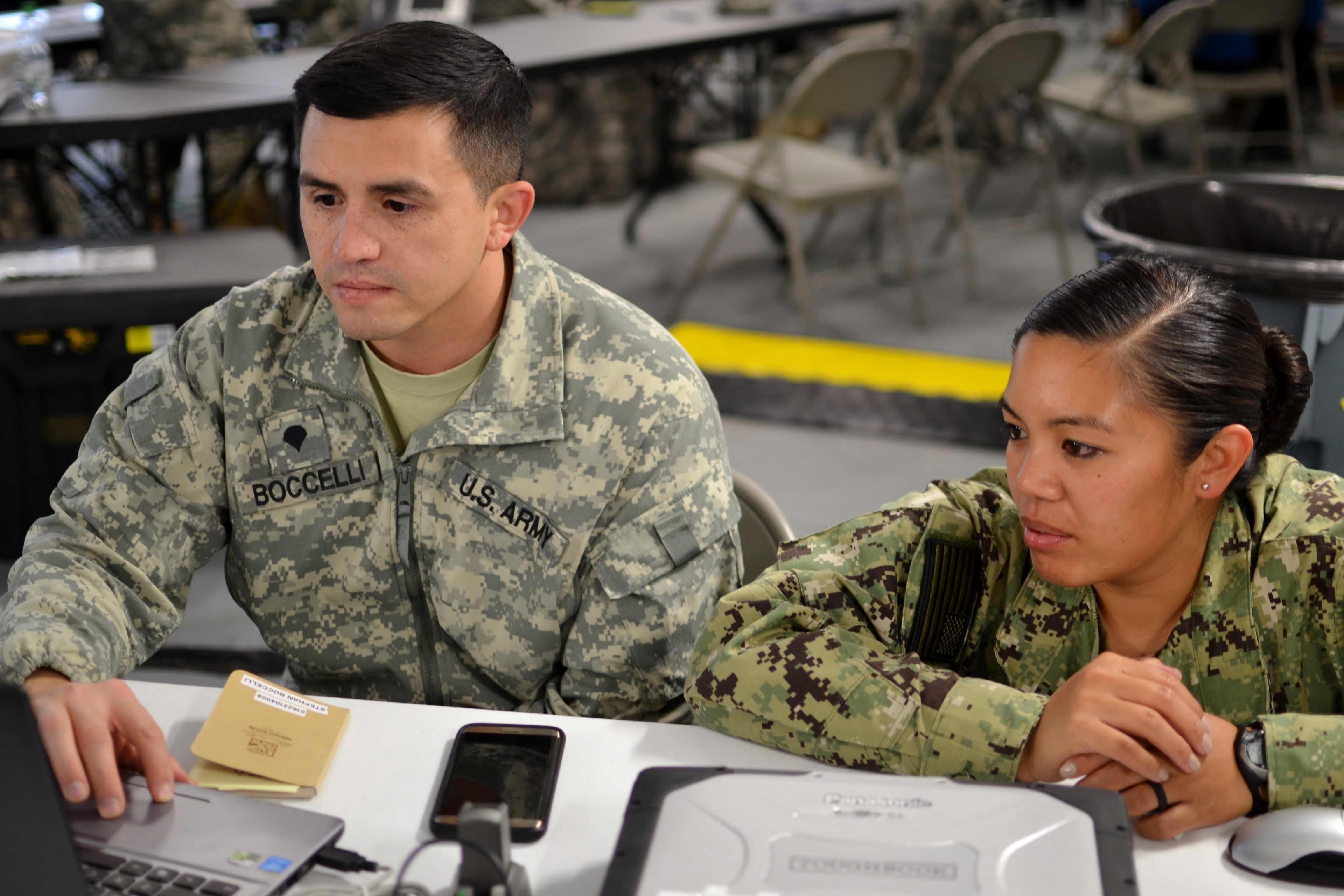 A Soldier and member of the U.S. Navy work on communication processes while setting up for exercise Anakonda Response 2016 on Papa Air Base, Hungary, April 27, 2016. This exercise will be implementing the Perspective Integration method during the mission, which requires mission planners to account for cultural factors in how gender roles affect men, women, boys and girls differently in a disaster. (U.S. Air National Guard photo by Tech. Sgt. Andria Allmond)