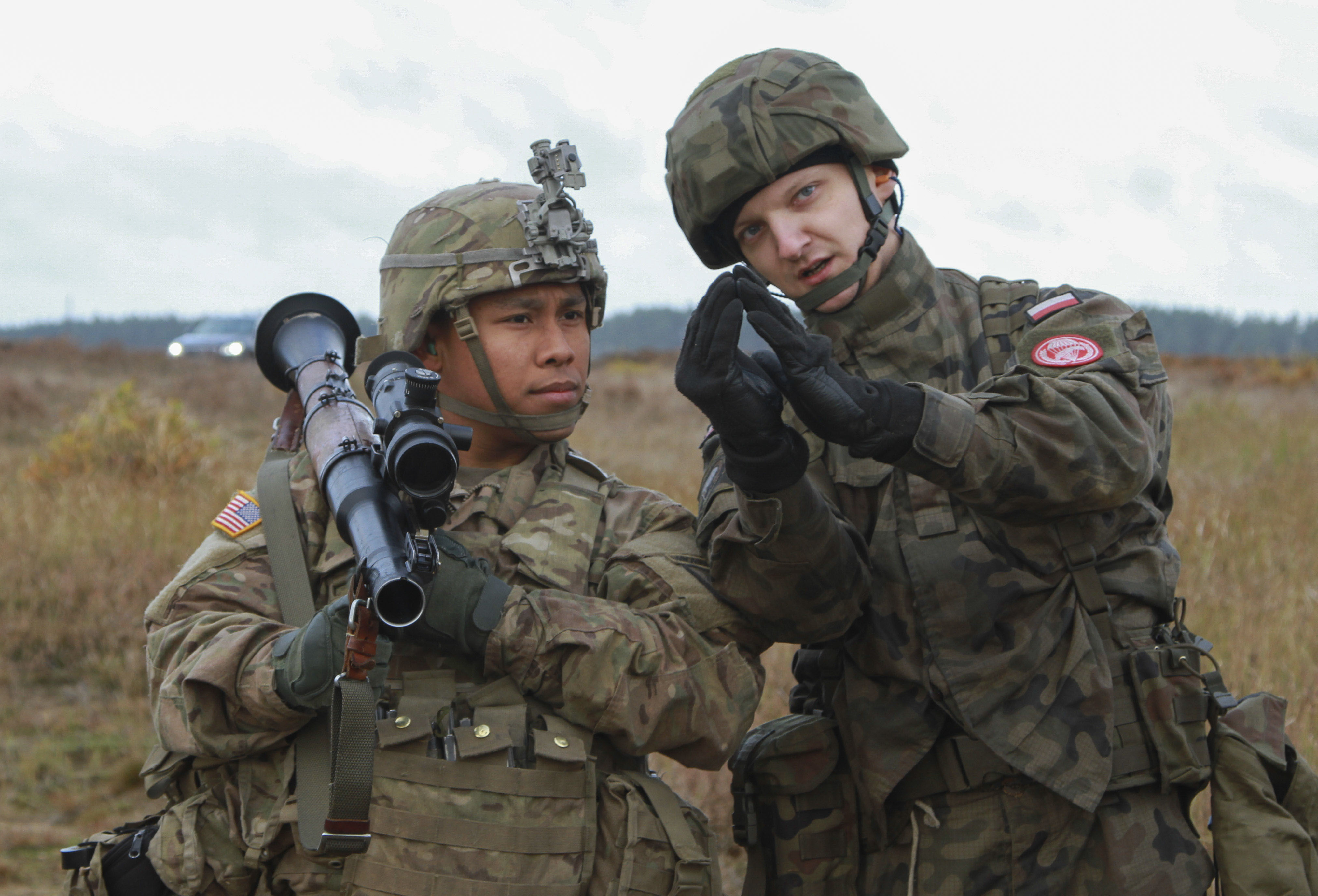 "DRAWSKO POMORSKIE, Poland – Spc. Jacob Quitugua, Paratrooper, Company D, 2nd Battalion, 503rd Infantry Regiment, 173rd Airborne Brigade, holds an RPG-7D Anti-Tank Grenade Launcher while Polish Pvt. Paweł Tylek, paratrooper, 16th Polish Airborne Battalion, 6th Airborne Brigade, describes the proper sight picture of the weapon during anti-tank training in Studnica, Poland, Oct. 29, 2016. The training provided both U.S. and Polish forces cross training on the M136 AT4 anti-tank weapon and the RPG-7D Anti-Tank Grenade Launcher. The ""Sky Soldiers"" of D Co., 2nd Bn., 503rd Inf. Regt., are on a training rotation in support of Operation Atlantic Resolve, a U.S. led effort in Eastern Europe that demonstrates U.S. commitment to the collective security of NATO and dedication to enduring peace and stability in the region. (U.S. Army photo by Sgt. Lauren Harrah/Released)"