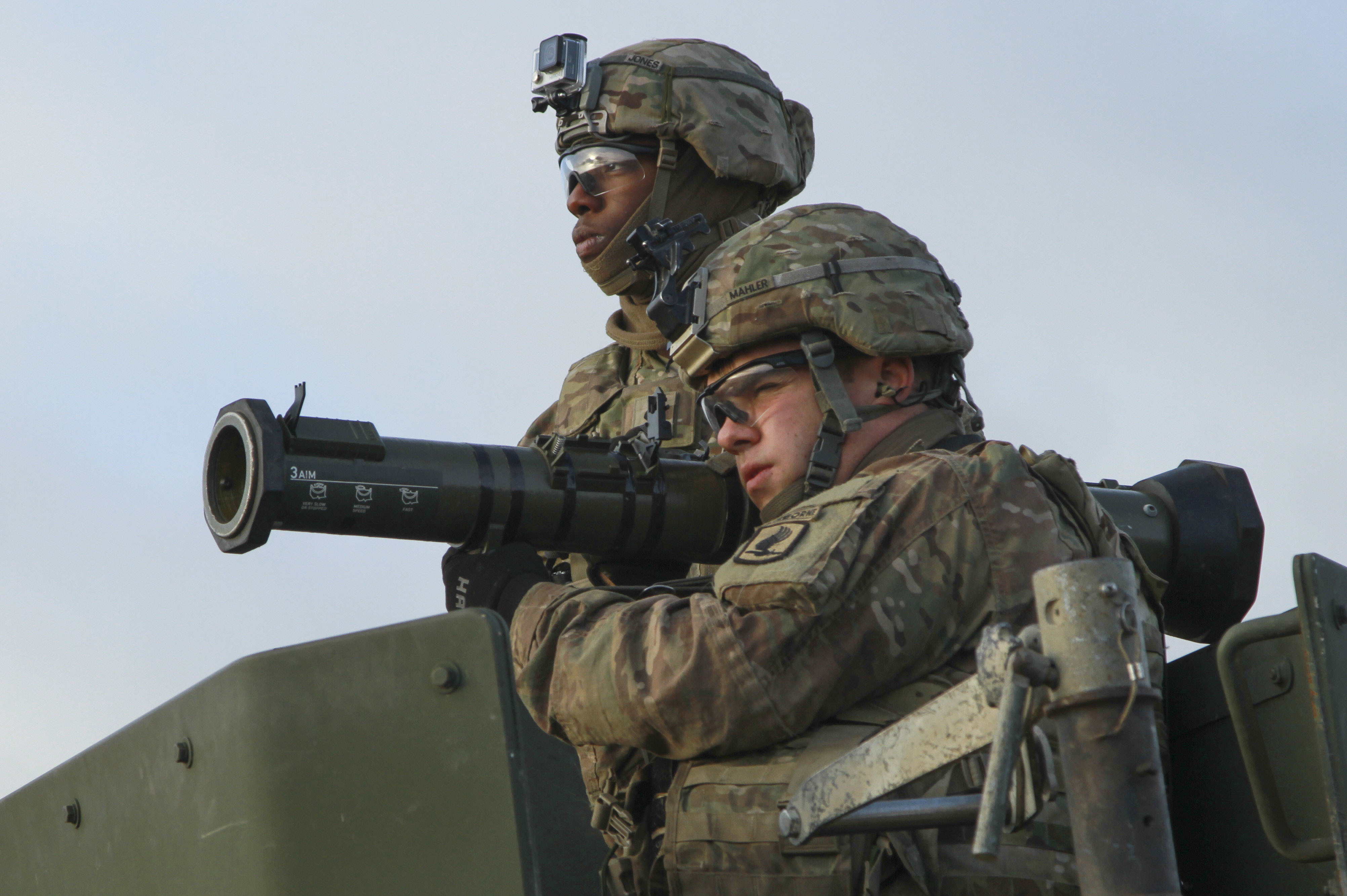 "DRAWSKO POMORSKIE, Poland – Spc. Joseph Mahler, Paratrooper, Company D, 2nd Battalion, 503rd Infantry Regiment, 173rd Airborne Brigade, acquires his target and prepares to fire 9mm tracer rounds from an M136 AT4 anti-tank weapon alongside Spc. Jacquez Jones, Paratrooper, D Co., 2nd Bn., 503rd Inf. Regt., during anti-tank training with Polish allies from the 16th Airborne Battalion, 6th Airborne Brigade, in Studnica, Poland Oct. 29, 2016. Paratroopers were able to hone their marksmanship skills with the AT4 anti-tank weapon, RPG-7D Anti-Tank Grenade Launcher, M320 grenade launcher and .50-caliber machine guns. The ""Sky Soldiers"" of D Co., 2nd Bn., 503rd Inf. Regt., are on a training rotation in support of Operation Atlantic Resolve, a U.S. led effort in Eastern Europe that demonstrates U.S. commitment to the collective security of NATO and dedication to enduring peace and stability in the region. (U.S. Army photo by Sgt. Lauren Harrah/Released)"