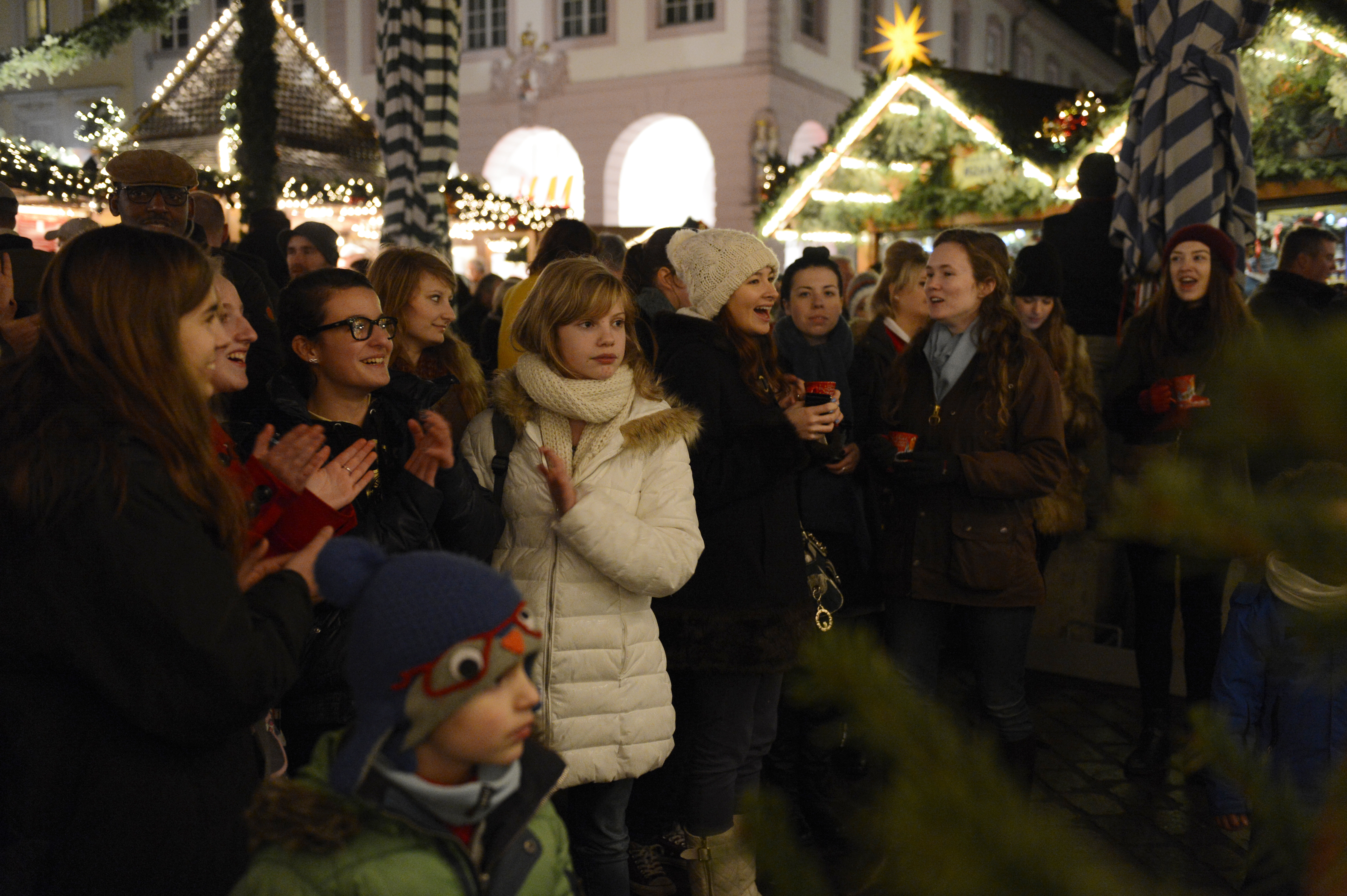 A crowd applauds after a holiday musical performance by Five Star Brass, the brass quintet of the U.S. Air Forces in Europe Band, at a Weihnachtsmarkt, or Christmas market, in Trier, Germany, Dec. 17, 2013. (U.S. Air Force photo by the Staff Sgt. Christopher Ruano/Released)