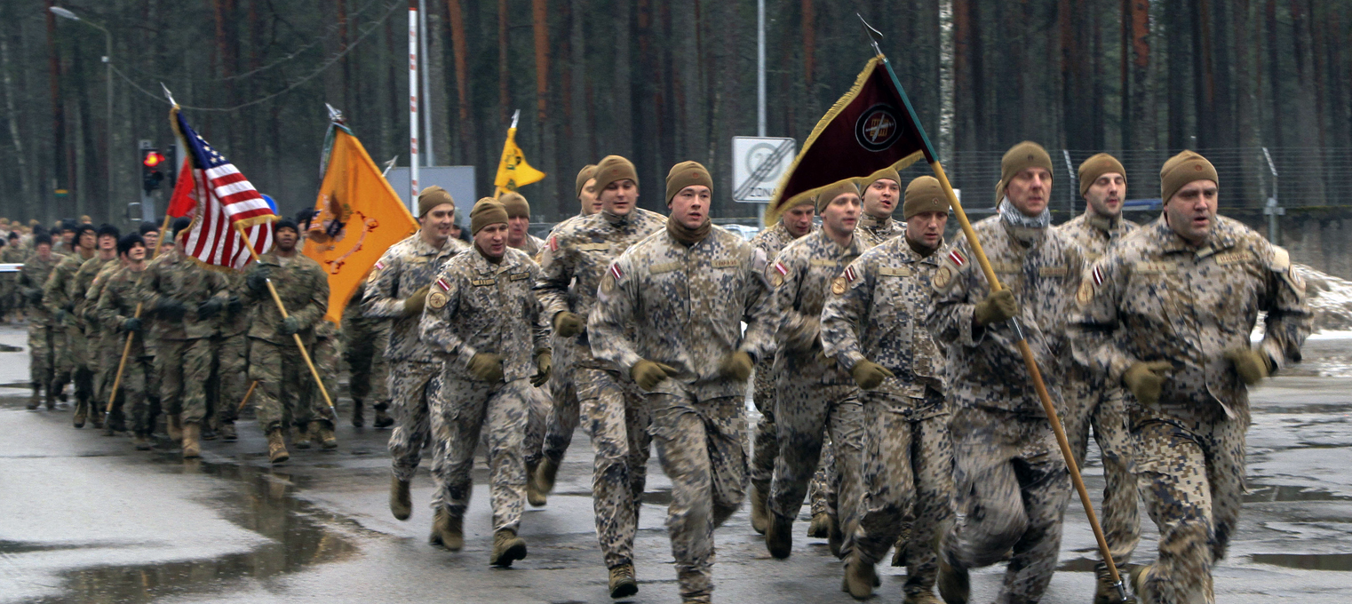 CAMP ADAZI, Latvia – Latvian soldiers assigned to the Latvian Land Forces Infantry Brigade and U.S. Army Soldiers assigned to 1st Battalion, 68th Armor Regiment, 3rd Armored Brigade, 4th Infantry Division, complete an esprit de corps run, Feb. 17, 2017 at Camp Adazi, Latvia. The run brought U.S. and Latvian soldiers together following a welcome ceremony honoring the arrival of 1-68 AR in support of Operation Atlantic Resolve. Atlantic Resolve is a U.S. led effort in Eastern Europe that demonstrates U.S. commitment to the collective security of NATO and dedication to the enduring peace and stability in the region. (U.S. Army photo by Sgt. Lauren Harrah/Released)
