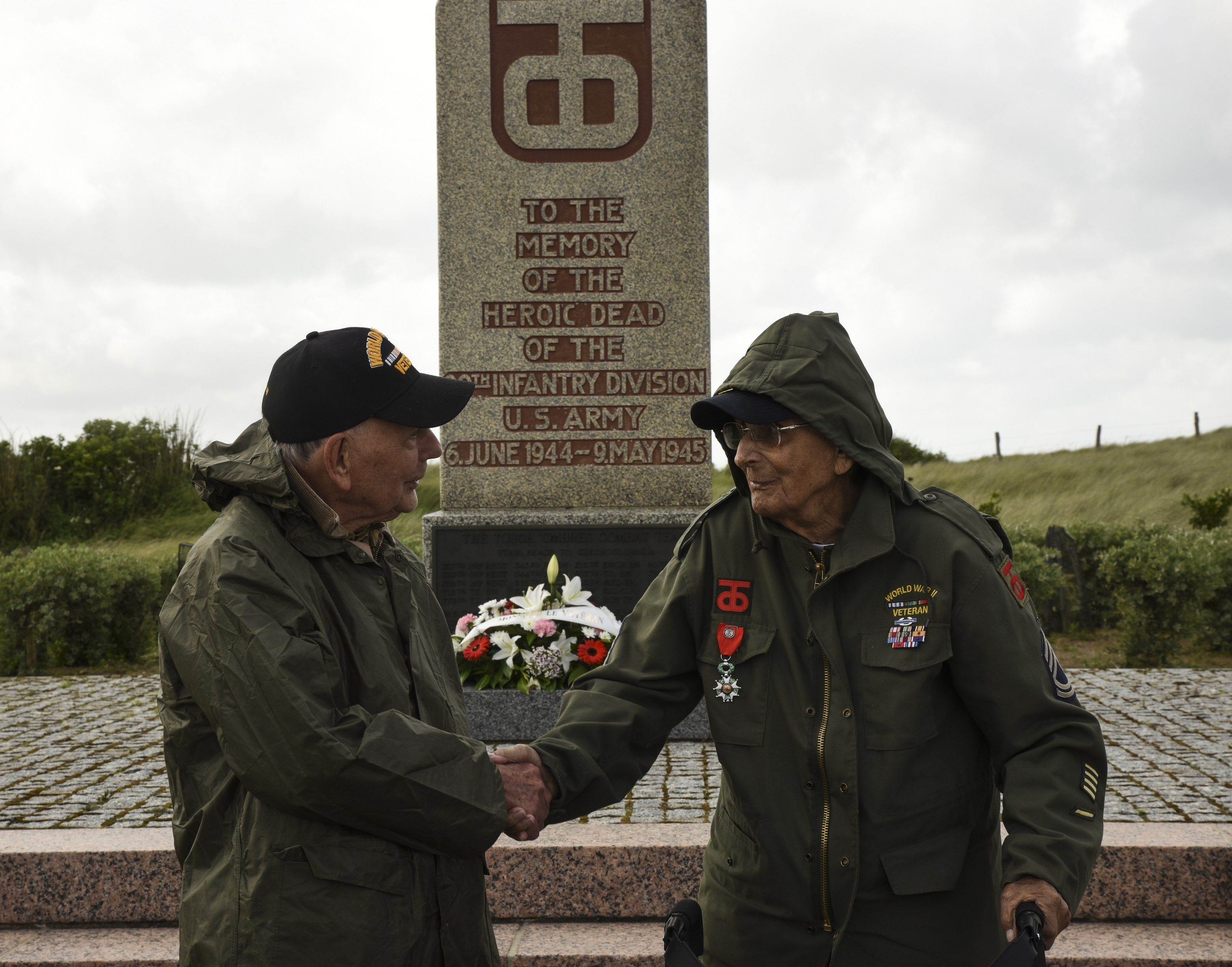 World War II veterans, Eugene Kliendl and Milton 'Milt' Staley, shake hands after laying a wreath at the foot of the 90th Infantry Division Monument, June 6, 2017, in Normandy, France. Kliendl and Staley both served with the division during D-Day.This ceremony commemorates the 73rd anniversary of D-Day, the largest multi-national amphibious landing and operational military airdrop in history, and highlights the U.S.' steadfast commitment to European allies and partners. Overall, approximately 400 U.S. servicemembers from units in Europe and the U.S. are participating in ceremonial D-Day events from May 31 to June 7, 2017.
