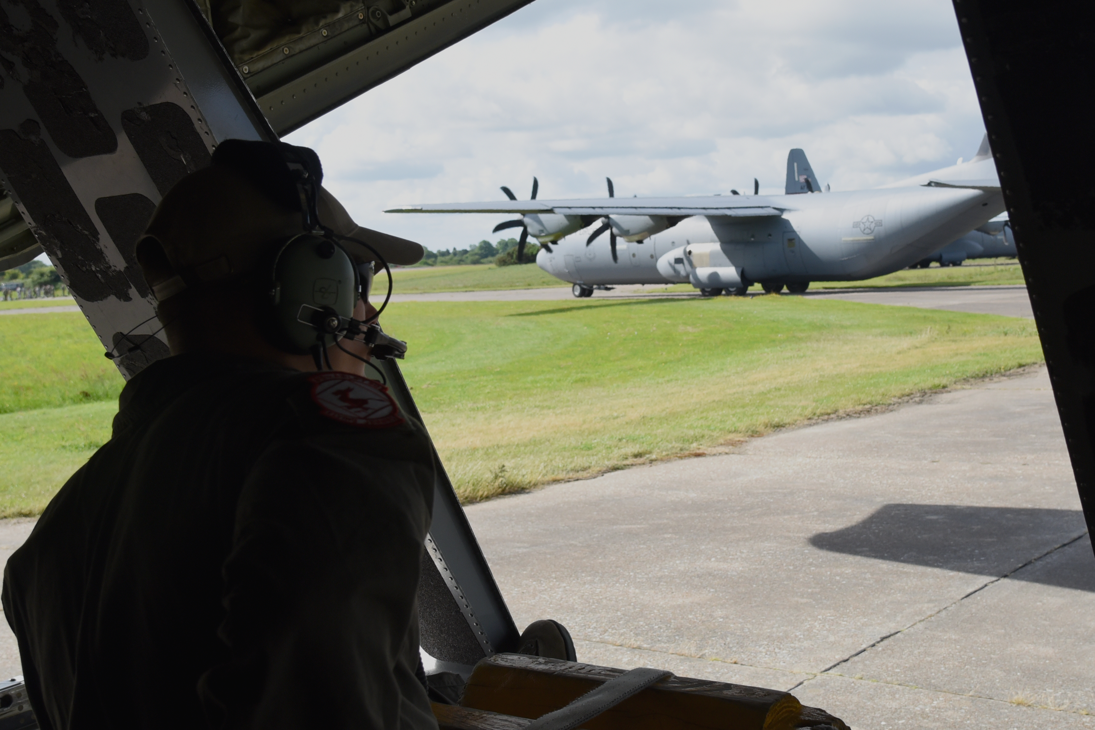 Senior Airman Shane Hague, loadmaster with the 815th Airlift Squadron, prepares to guide pilots as they back out of their parking spot before taking part in a paratroop drop over Normandy, France. This event commemorates the 73rd anniversary of D-Day, the largest multi-national amphibious landing and operational military airdrop in history, and highlights the U.S.' steadfast commitment to European allies and partners. Overall, approximately 400 U.S. service members from units in Europe and the U.S. are participating in ceremonial D-Day events from May 31 to June 7, 2017(U.S. Air Force photo by Staff Sgt. Nicholas Monteleone)