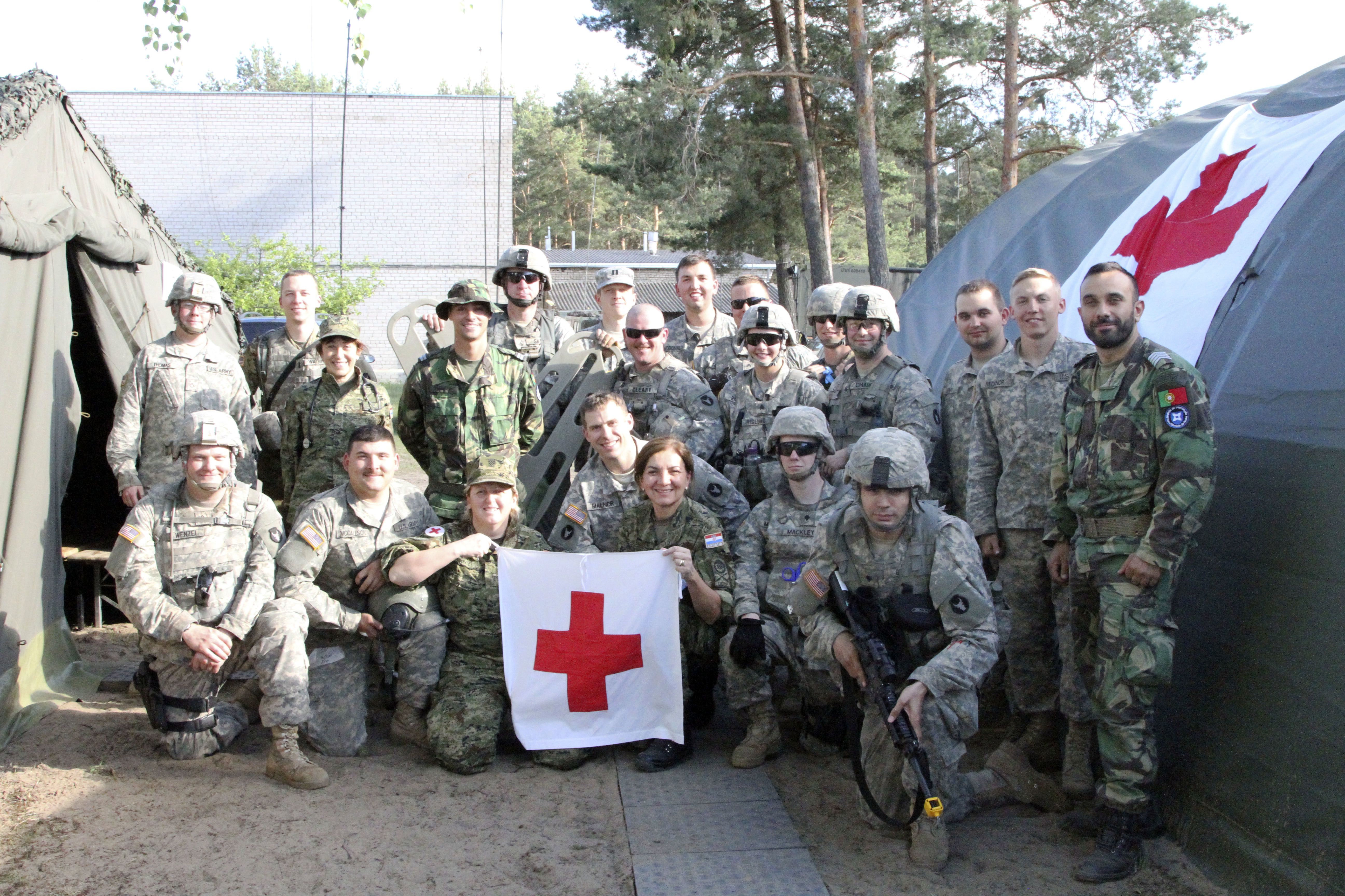 Minnesota Army National Guard Medical Soldiers work alongside Croatian and Portuguese Medical Soldiers to provide simulated and real-life Medical care during a 3-day Situational Training Exercise in Pabrade, Lithuania, during exercise Iron Wolf, Saber Strike '17. Exercise Saber Strike is a US Army Europe-led theater exercise designed to enhance interoperability between NATO forces and key regional partners. (US Army photo by Sgt. Amberlee Boverhuis/RELEASED)