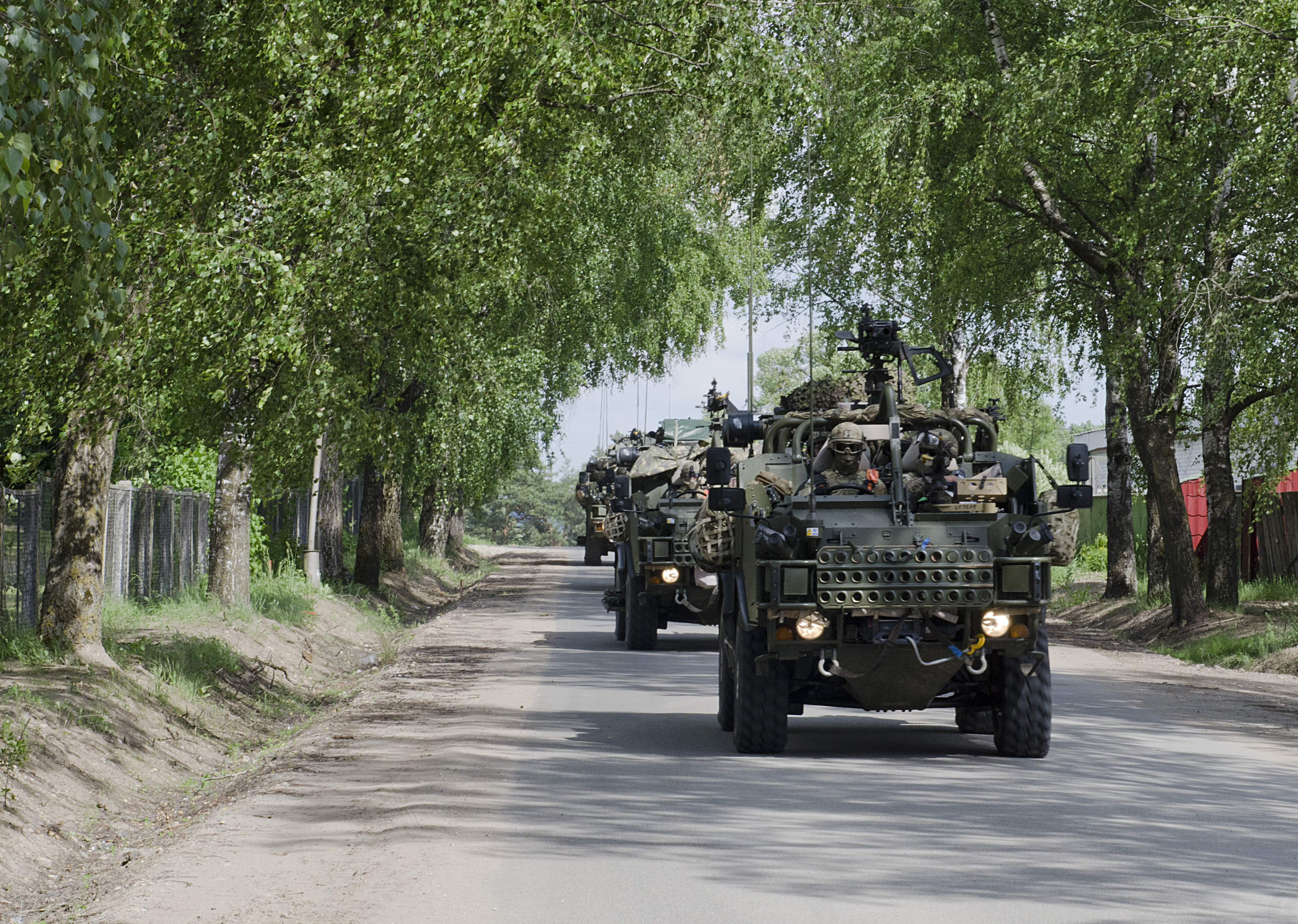 British Soldiers with Enhanced Forward Presence Battle Group Poland arrived to Rukla, Lithuania after a two-day tactical road march across Eastern Europe, June 18, 2017, as part of Saber Strike 17. The Poland-based Battle Group conducted the convoy portion of the Field Training Exercise to demonstrate their ability to execute a forward passage of lines across the only land connection between the Baltic States of Estonia, Latvia and Lithuania, which is known as the Suwalki Gap. (U.S. Army photo by Sgt. Justin Geiger)