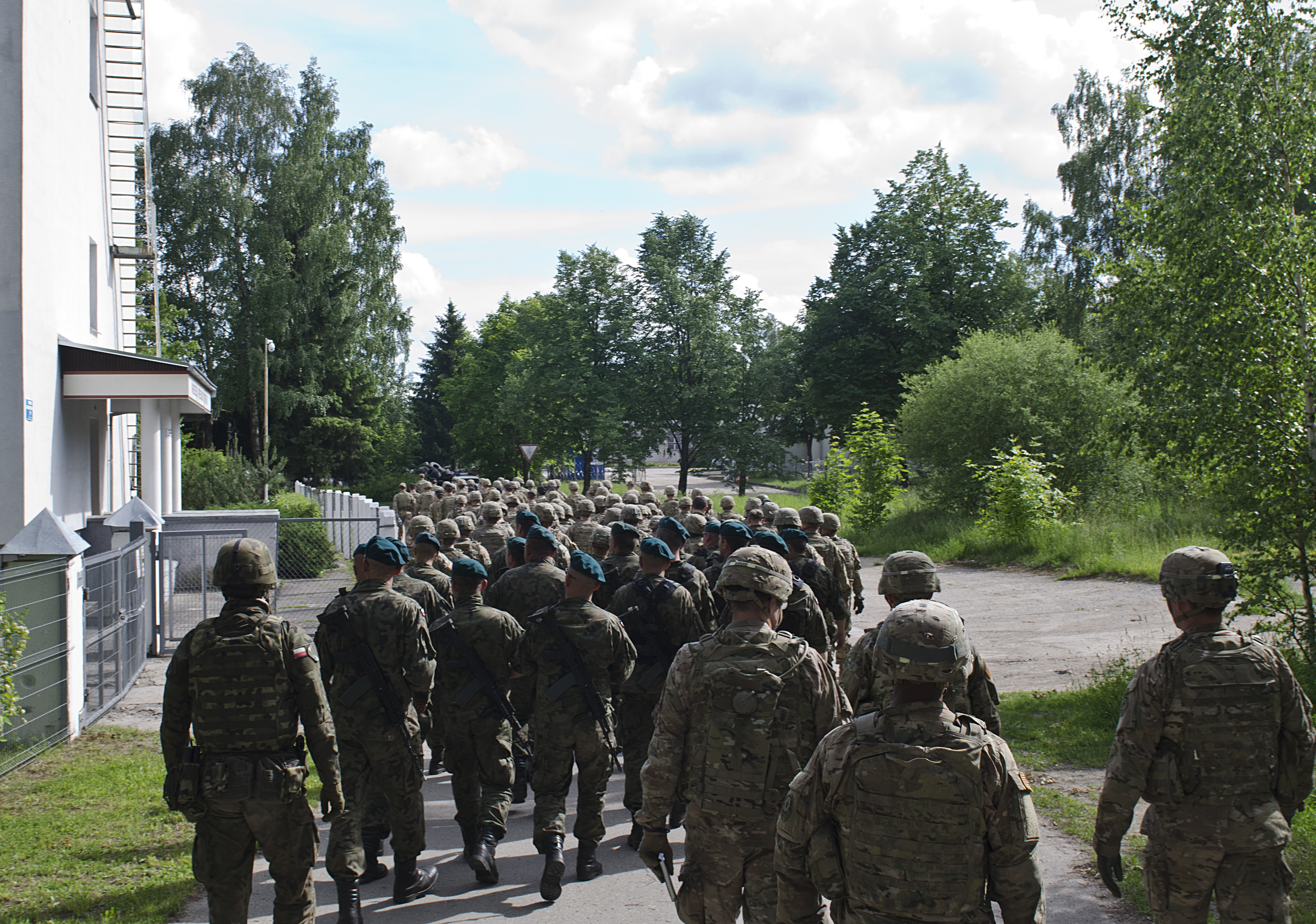 Once all equipment and personnel was accounted for, the Battle Group Soldiers attended a reception brief in Rukla, Lithuania after a two-day tactical road march across Eastern Europe, June 18, 2017, as part of Saber Strike 17. The Poland-based Battle Group conducted the convoy portion of the Field Training Exercise to demonstrate their ability to execute a forward passage of lines across the only land connection between the Baltic States of Estonia, Latvia and Lithuania, which is known as the Suwalki Gap. (U.S. Army photo by Sgt. Justin Geiger)