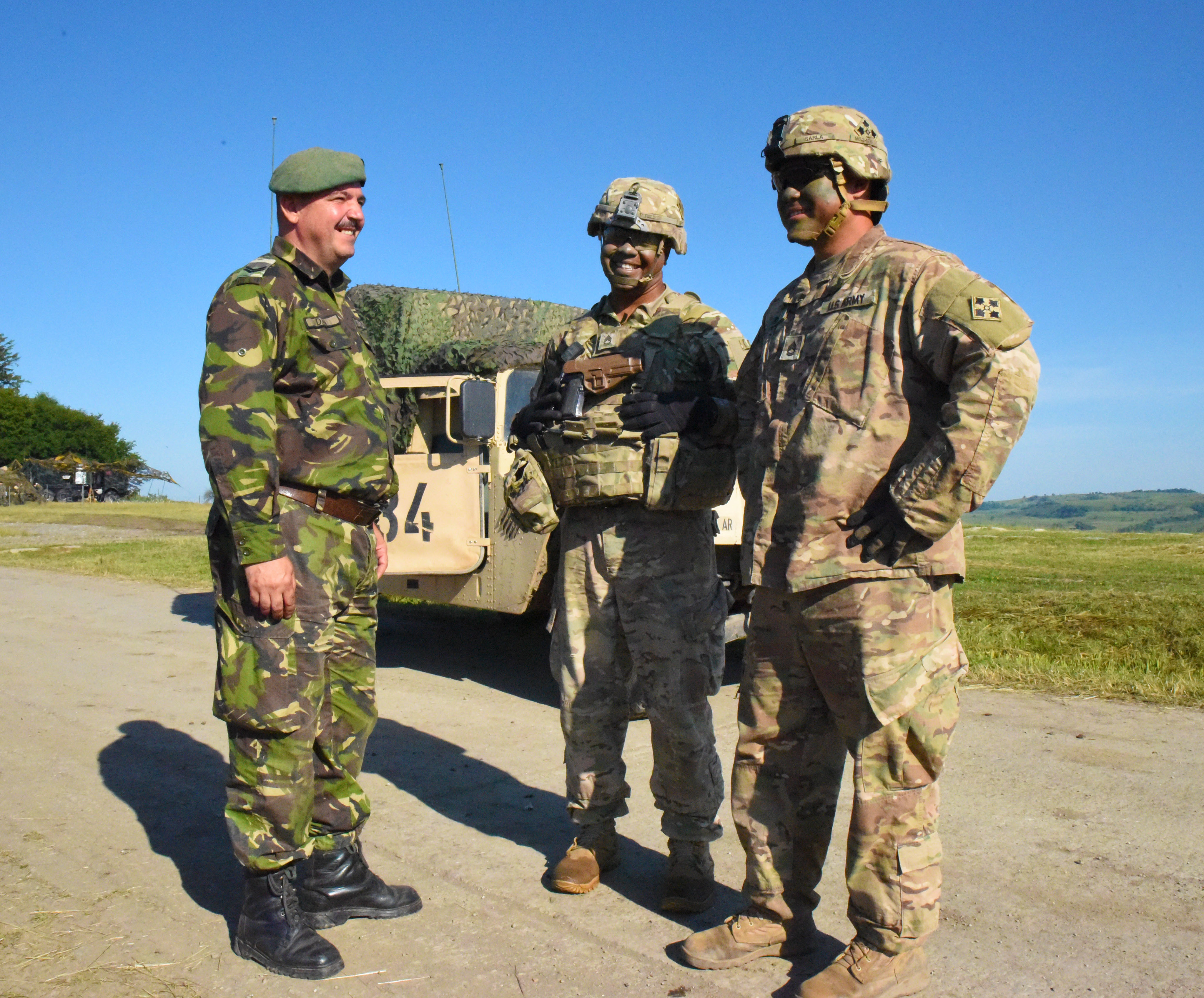 CINCU, Romania - U.S. Army Soldiers of 1st battalion, 66th armored regiment, 3rd Armored Brigade Combat Team speaks with Soldiers of the Romanian army during Getica Saber 17, July 10, 2017. Getica Saber 17 is a U.S-led fire  support coordination exercise and combined arms live fire exercise that incorporates six Allied and partner nations with more than 4,000 Soldiers. Getica Saber 17 runs concurrent with Saber Guardian 17, a U.S. Army Europe-led, multinational exercise that spans across Bulgaria, Hungary and Romania with more than 25,000 service members from 22 Allied and partner nations.