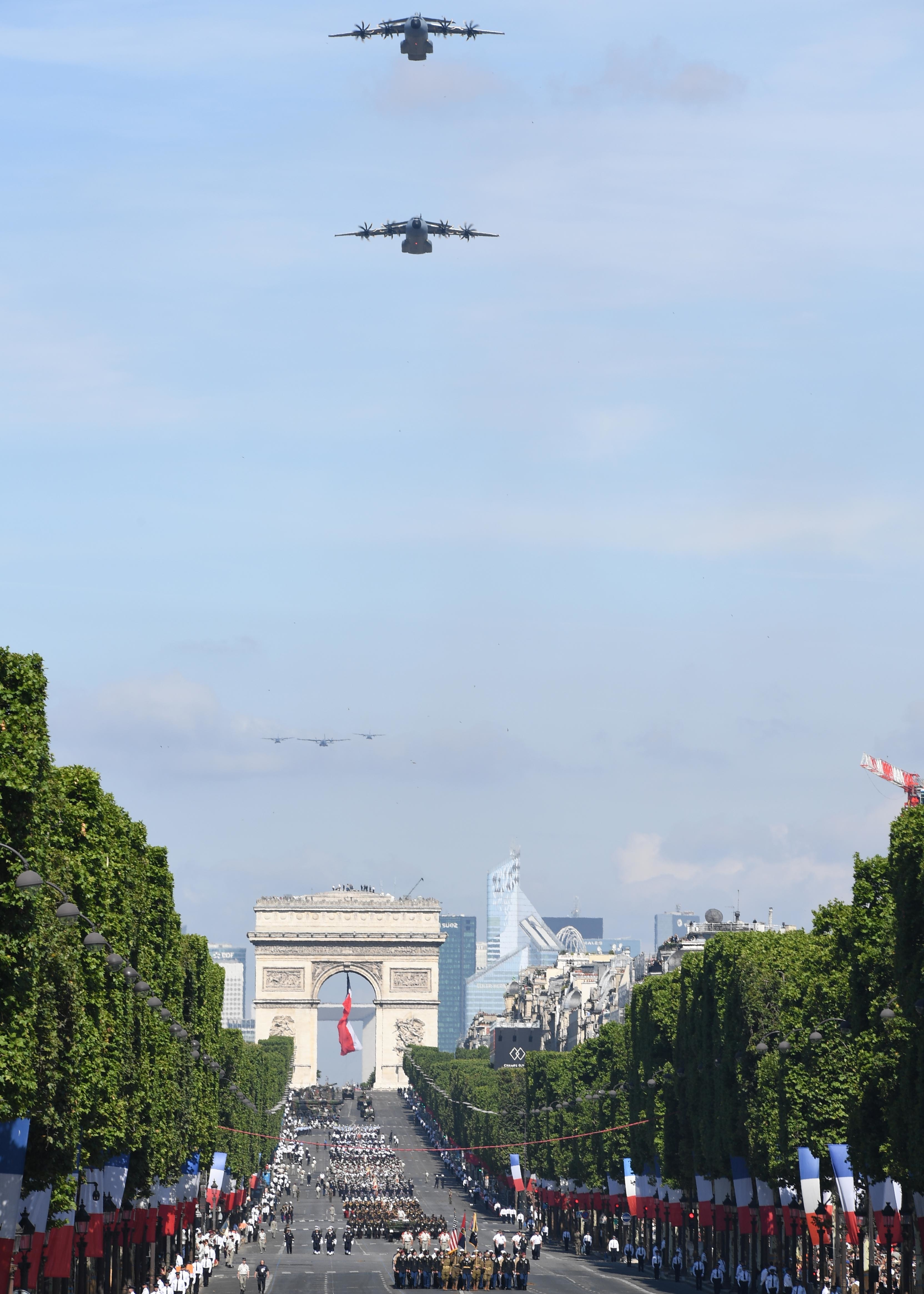 170714-N-AC979-354 PARIS (July 14, 2017) French aircraft conduct a flyover over the Avenue des Champs-Elysées during the Military Parade on Bastille Day. This year's parade included more than 90 aircraft and helicopters, 200 vehicles and 3,700 participants. (U.S. Navy photo by Chief Mass Communication Specialist Michael McNabb/Released)