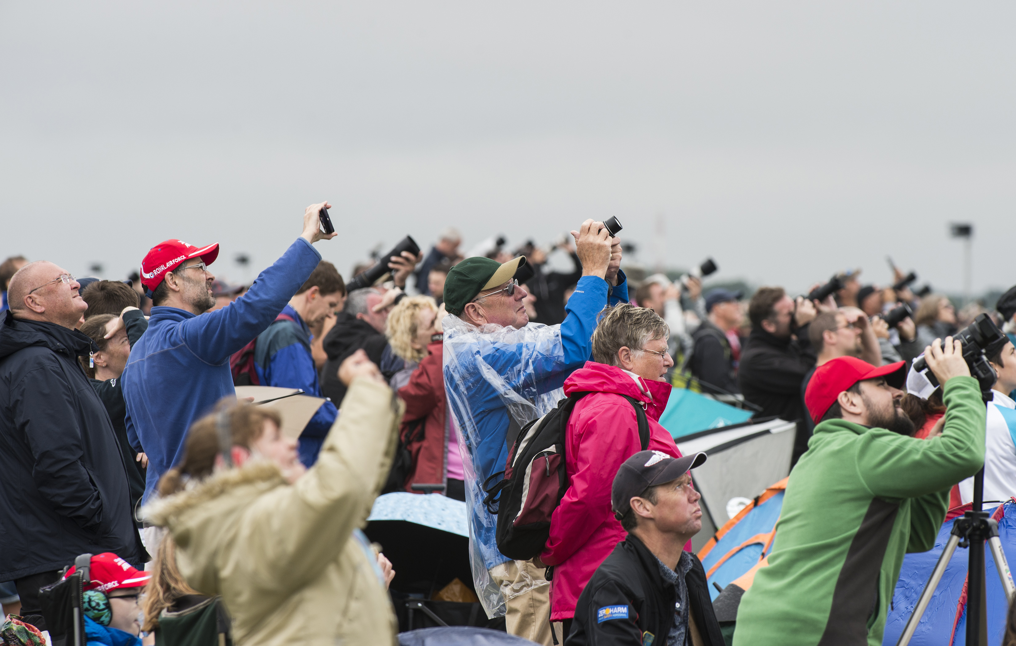 FAIRFORD, United Kingdom – Spectators take photos of aircraft during the 2017 Royal International Air Tattoo (RIAT) located at RAF Fairford, United Kingdom, on July 15, 2017. This year commemorates the U.S. Air Force's 70th Anniversary which was highlighted during RIAT by displaying its lineage and advancements in military aircraft. (U.S. Air Force Photo by Tech. Sgt. Brian Kimball)