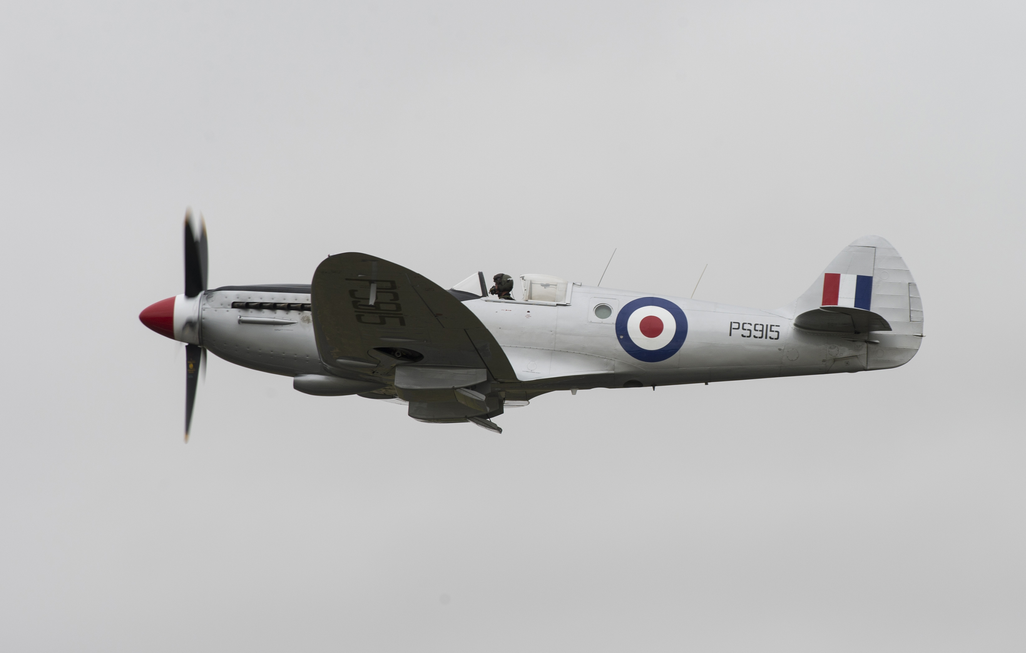FAIRFORD, United Kingdom – A VS Spitfire aircraft flies past spectators during the 2017 Royal International Air Tattoo (RIAT) located at RAF Fairford, United Kingdom, on July 15, 2017. This year commemorates the U.S. Air Force's 70th Anniversary which was highlighted during RIAT by displaying its lineage and advancements in military aircraft. (U.S. Air Force Photo by Tech. Sgt. Brian Kimball)