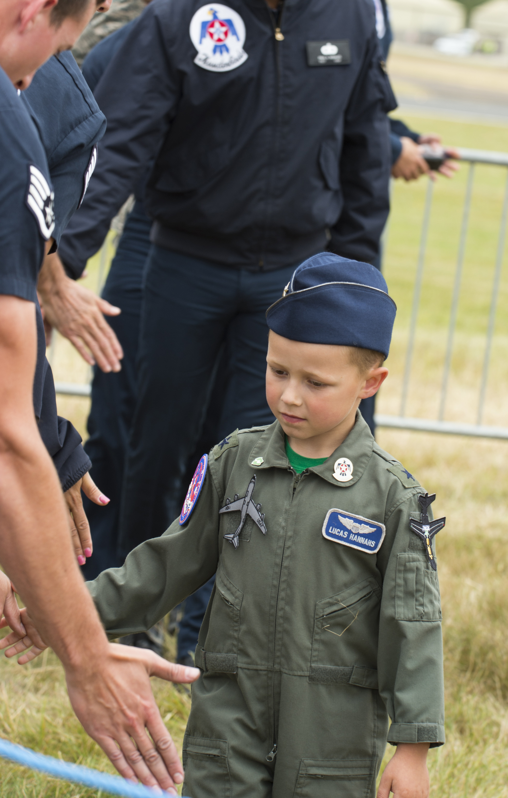 FAIRFORD, United Kingdom –Lucas Hannahs (right), a U.S. Air Force military dependent, meets with members of the U.S. Air Force Thunderbird aeronautical team during the 2017 Royal International Air Tattoo (RIAT) located at RAF Fairford, United Kingdom, on July 15, 2017. This year commemorates the U.S. Air Force's 70th Anniversary which was highlighted during RIAT by displaying its lineage and advancements in military aircraft. (U.S. Air Force Photo by Tech. Sgt. Brian Kimball)
