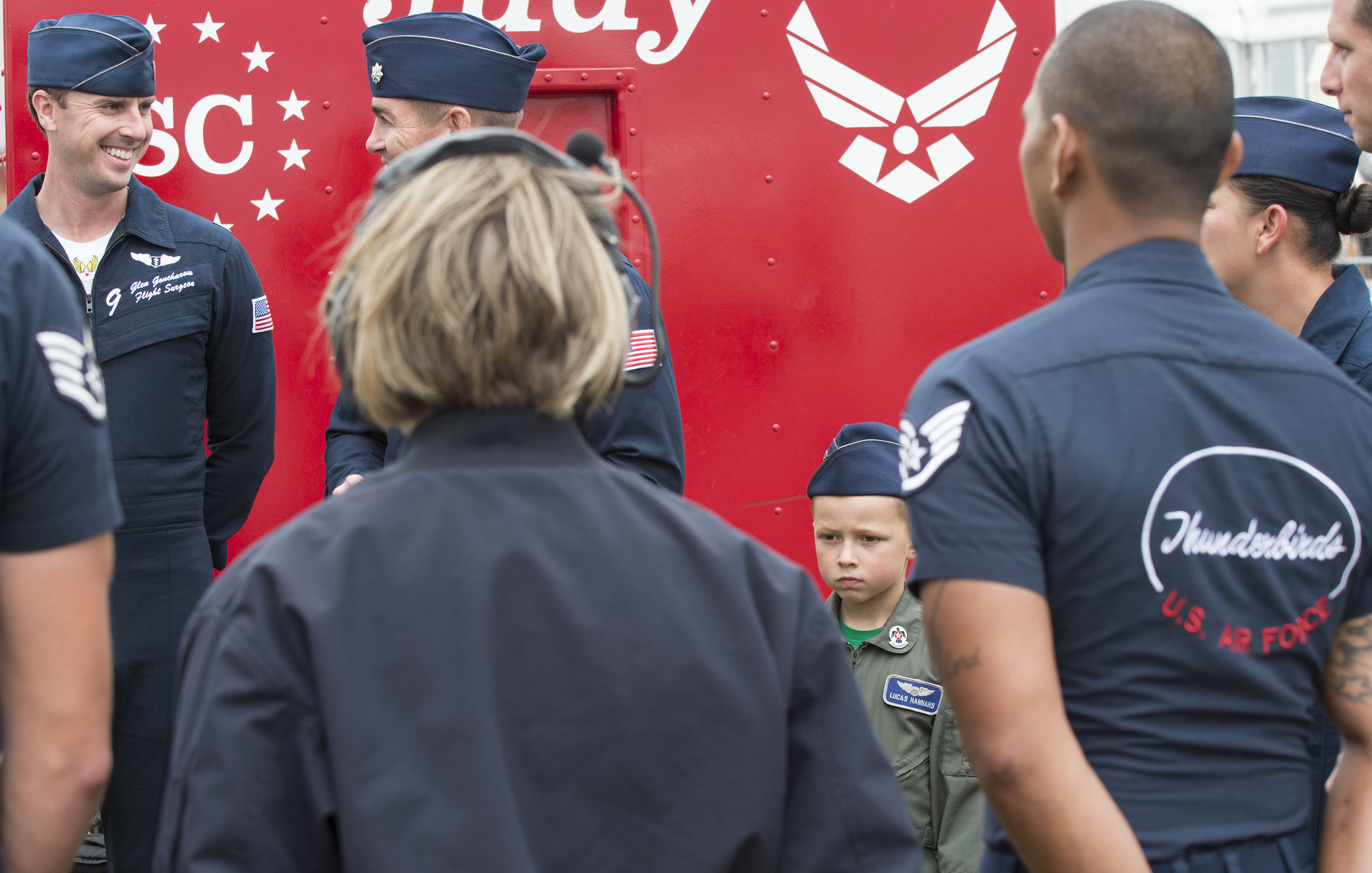 FAIRFORD, United Kingdom –Lucas Hannahs (right), a U.S. Air Force military dependent, stands with members of the U.S. Air Force Thunderbird aeronautical team during the 2017 Royal International Air Tattoo (RIAT) located at RAF Fairford, United Kingdom, on July 15, 2017. This year commemorates the U.S. Air Force's 70th Anniversary which was highlighted during RIAT by displaying its lineage and advancements in military aircraft. (U.S. Air Force Photo by Tech. Sgt. Brian Kimball)