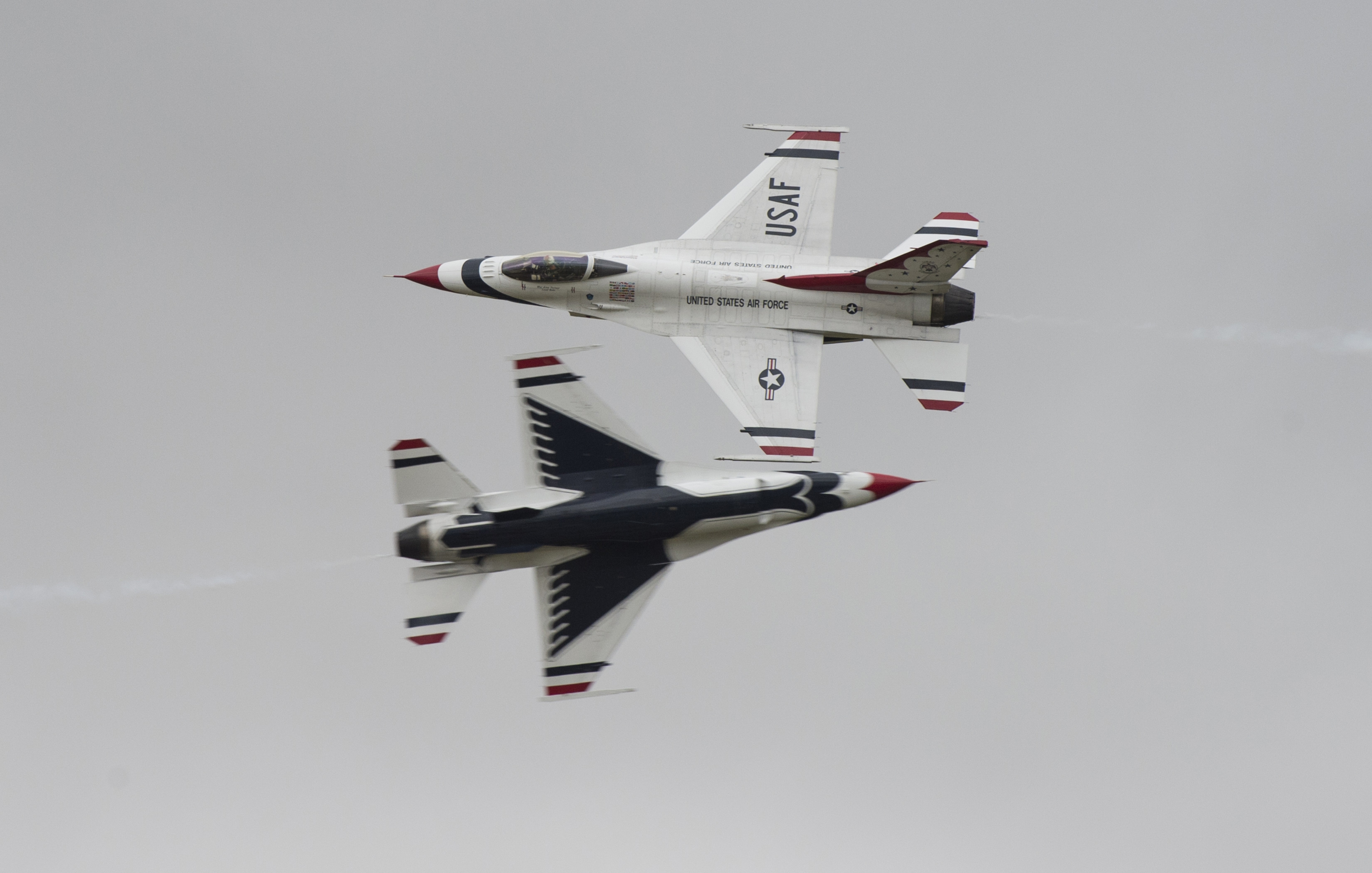 FAIRFORD, United Kingdom – Two U.S. Air Force Thunderbird F-16 aircraft fly past spectators during the 2017 Royal International Air Tattoo (RIAT) located at RAF Fairford, United Kingdom, on July 15, 2017. This year commemorates the U.S. Air Force's 70th Anniversary which was highlighted during RIAT by displaying its lineage and advancements in military aircraft. (U.S. Air Force Photo by Tech. Sgt. Brian Kimball)