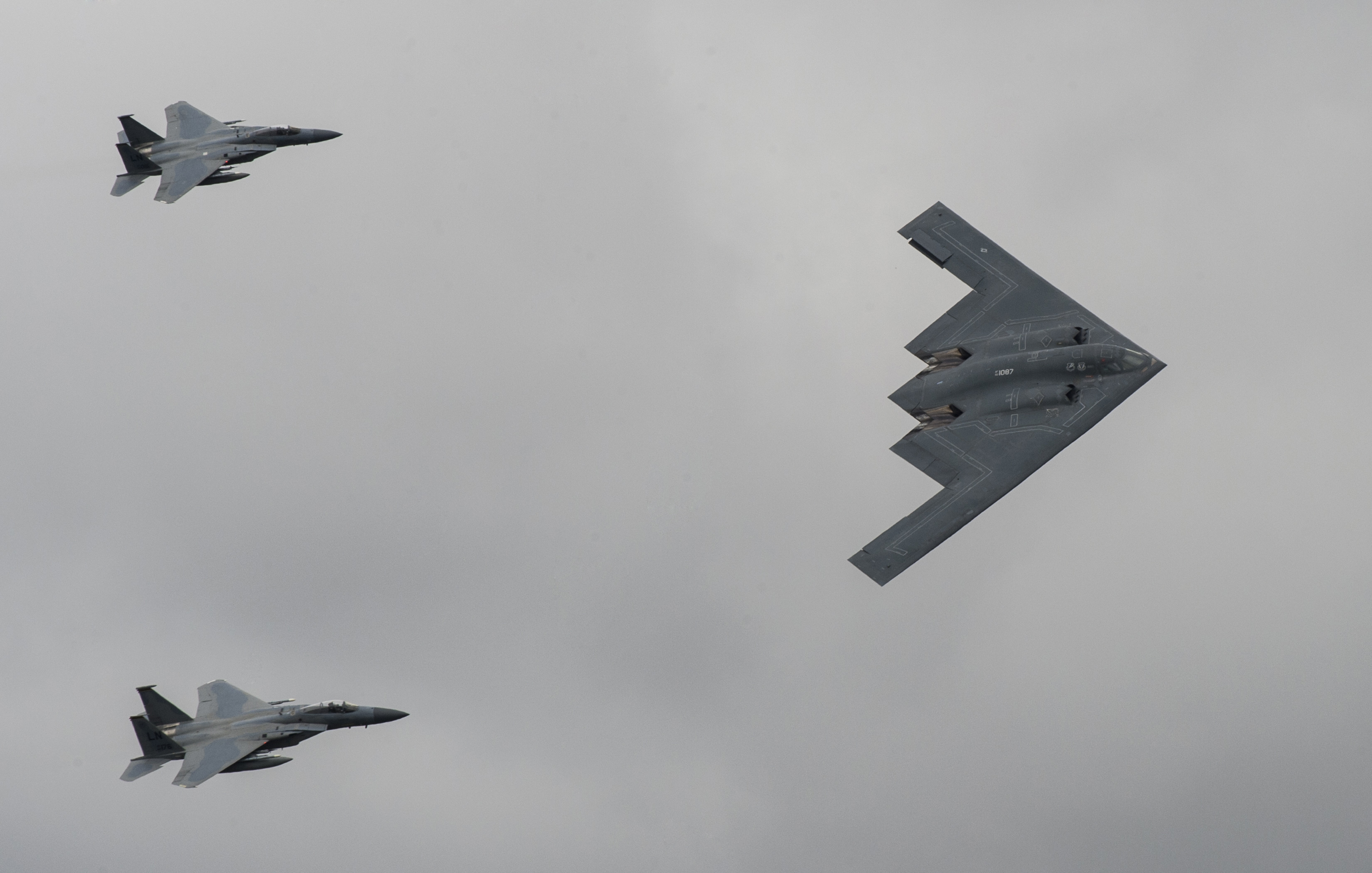 FAIRFORD, United Kingdom  – A U.S. Air Force B-2 Stealth Bomber and Two F-15 aircraft fly past spectators during the 2017 Royal International Air Tattoo (RIAT) located at RAF Fairford, United Kingdom, on July 16, 2017. This year commemorates the U.S. Air Force's 70th Anniversary which was highlighted during RIAT by displaying its lineage and advancements in military aircraft. (U.S. Air Force Photo by Tech. Sgt. Brian Kimball)