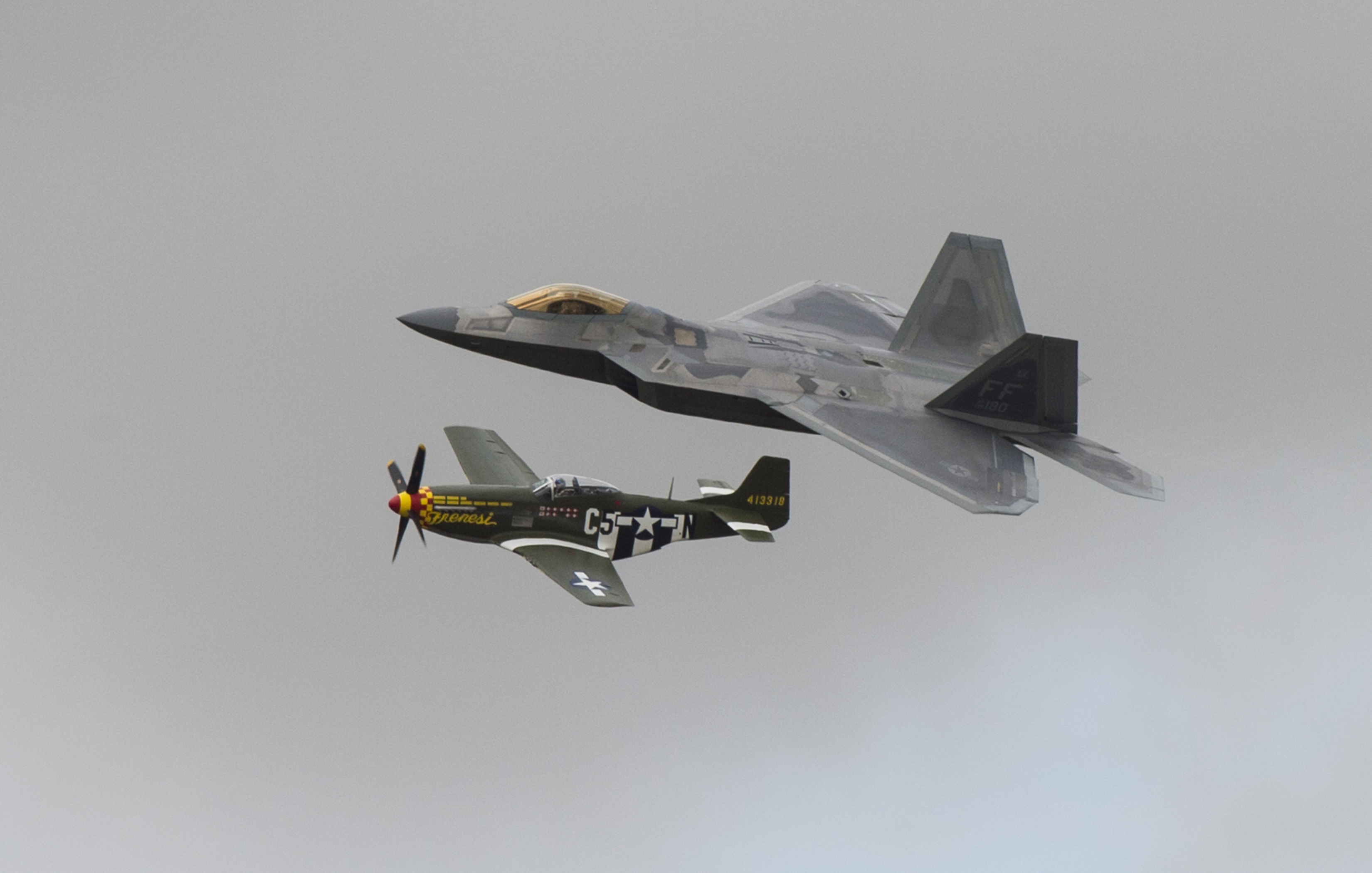 FAIRFORD, United Kingdom – A U.S. Air Force F-22 Raptor and P-51 Mustang fly past spectators during a U.S. Air Force heritage flight at the 2017 Royal International Air Tattoo (RIAT) located at RAF Fairford, United Kingdom, on July 16, 2017. This year commemorates the U.S. Air Force's 70th Anniversary which was highlighted during RIAT by displaying its lineage and advancements in military aircraft. (U.S. Air Force Photo by Tech. Sgt. Brian Kimball)