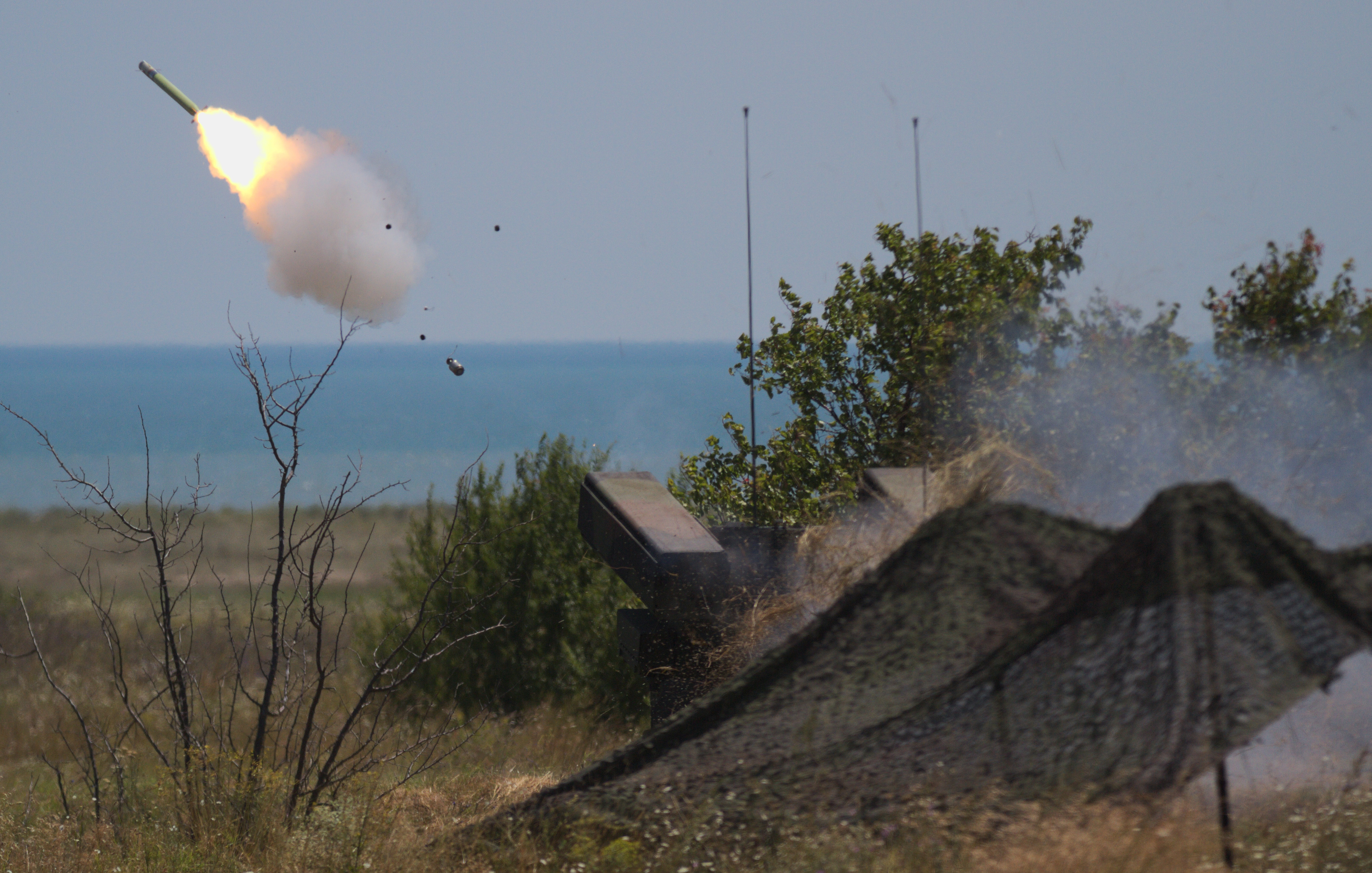 An AN/TWQ-1 Avenger air defense system fires a missile over the Black Sea at Capu Midia Training Area, Romania on July 19, 2017. The drill allowed gunners to fire live missiles as part of Tobruq Legacy, an air defense exercise where the US and its NATO Allies and partners share new knowledge, techniques and strategies to enhance air defense capabilities in Eastern Europe. (Photo by U.S. Army Pfc. Nicholas Vidro, 7th Mobile Public Affairs Detachment)