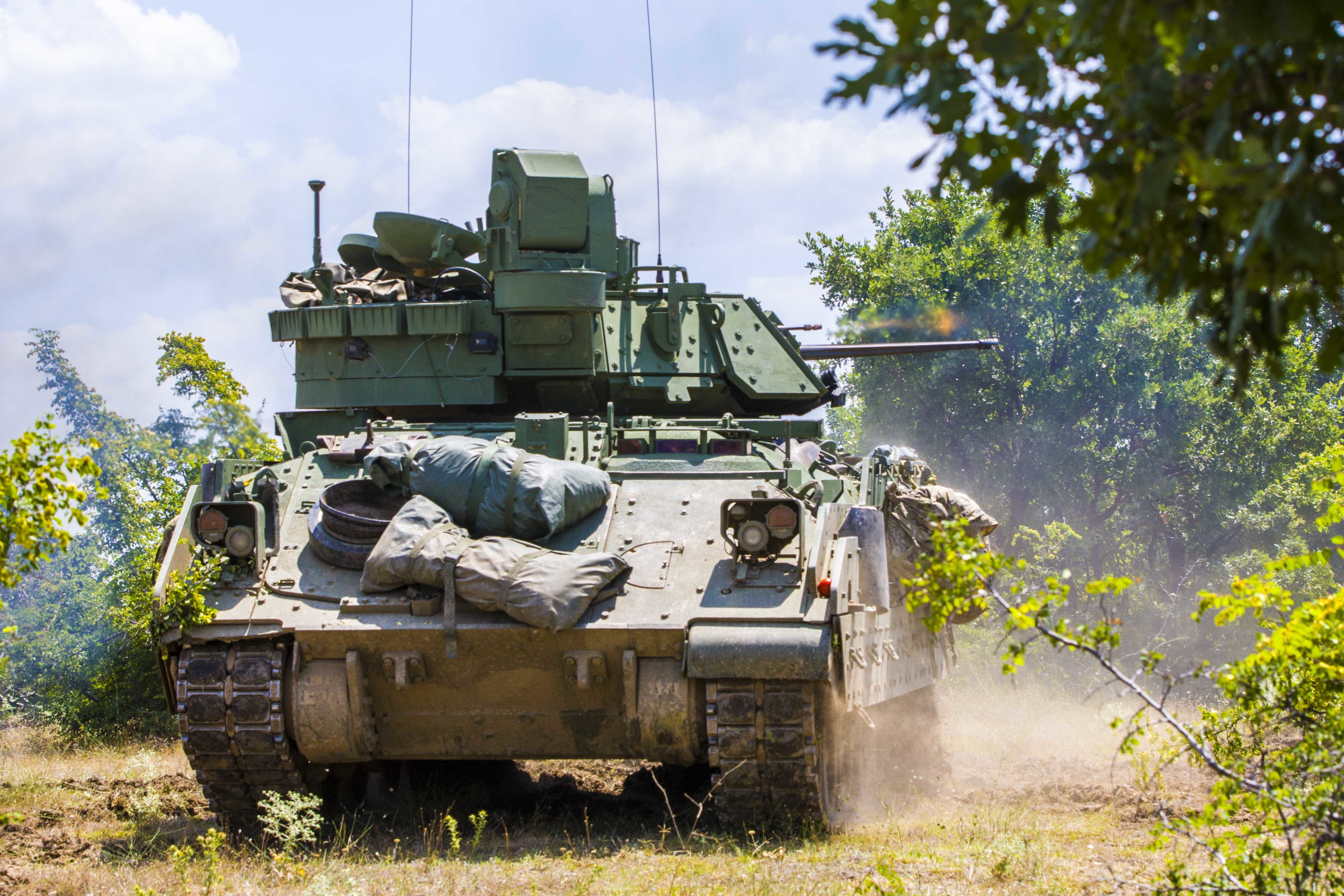 A Bradley Fighting Vehicle from 1st Battalion, 8th Infantry Regiment, 4th Infantry Division, fires on enemy forces during a combined live fire exercise titled Peace Sentinel at Koren, Bulgaria, on July 19. Exercise Saber Guardian 17 is a U.S. European Command, U.S. Army Europe-led exercise in the Black Sea Region that builds readiness and improves interoperability among the 20 Allies who participate. (U.S. Army photo by Spc. Thomas Scaggs) 170717-A-TZ475-446