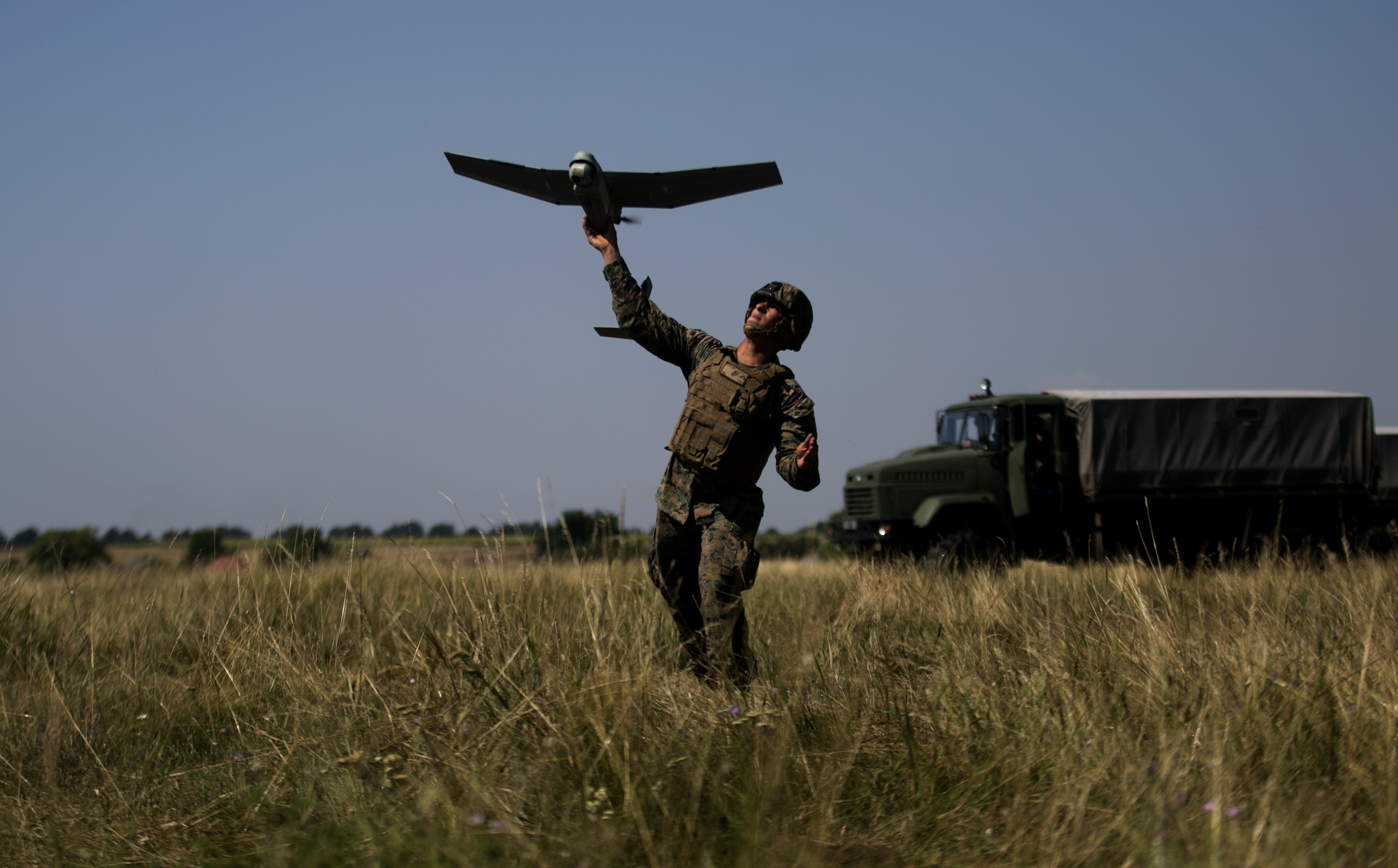 A U.S. Marine with Black Sea Rotational Force 17.1 launches an unmanned aerial vehicle during exercise  Sea Breeze 2017 in Nikolaev. Ukraine, July 19. Sea Breeze is a U.S. and Ukraine co-hosted multinational maritime exercise held in the Black Sea and is designed to enhance interoperability of participating nations and strengthen maritime security within the region. (U.S. Marine Corps photo by Cpl. Sean J. Berry/Released)
