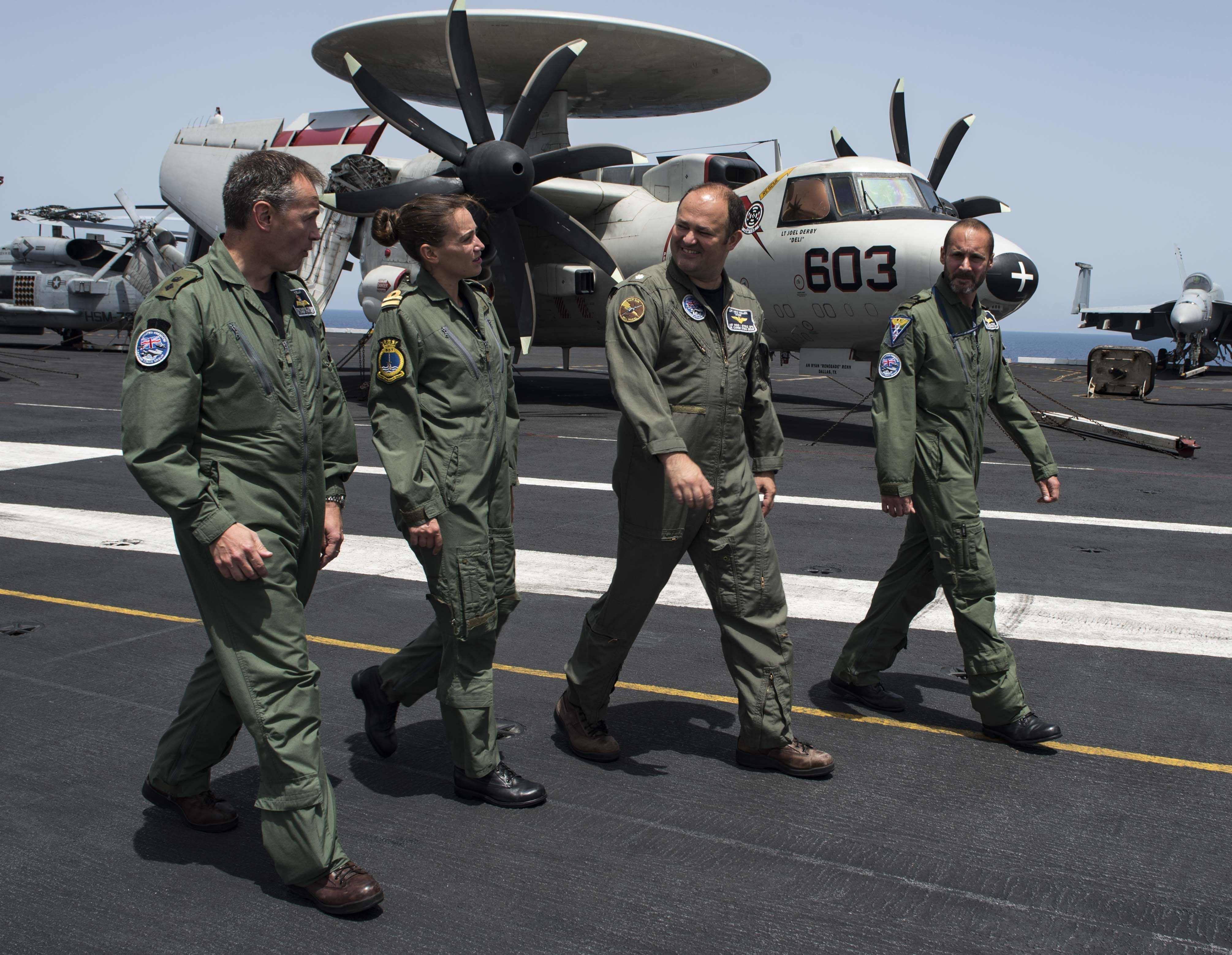170721-N-AJ467-184 MEDITERRANEAN SEA (July 22, 2017) Officers from the U.K. Carrier Strike Group Staff tour the flight deck of the aircraft carrier USS George H.W. Bush (CVN 77). The officers are embarked in preparation for Exercise Saxon Warrior, a keystone exercise as the U.K. prepares for the arrival of the HMS Queen Elizabeth. The GHWB and its carrier strike group are conducting naval operations in the U.S. 6th Fleet area of operations in support of U.S. national security interests in Europe and Africa. (U.S. Navy photo by Mass Communication Specialist Seaman Darien Weigel/Released)