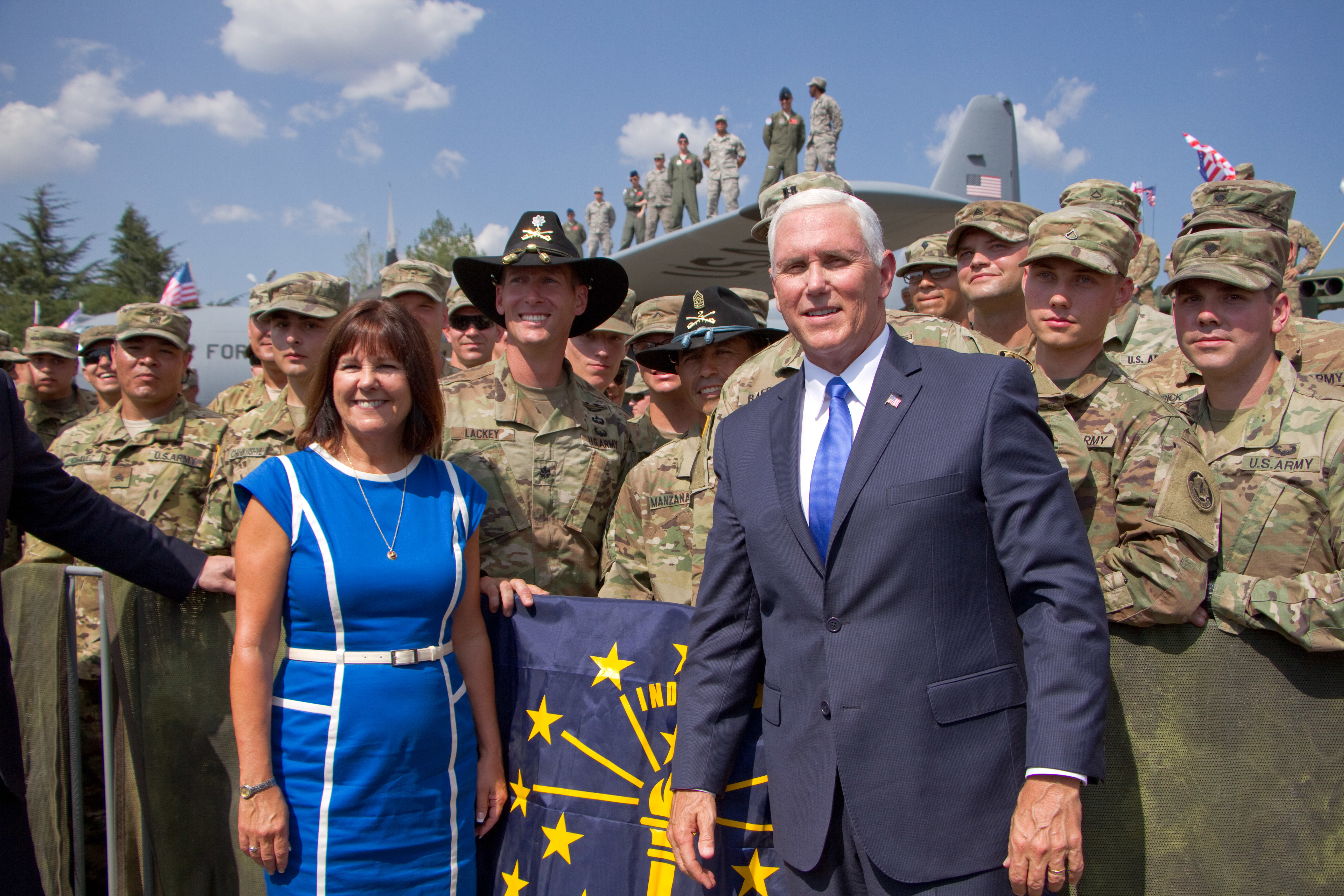 Vice President Mike Pence and wife Karen Pence pose for a photo with (in Cavalry Stetsons) Lt. Col. Adam Lackey, commander of 1st Squadron, 2d Cavalry Regiment and Command Sgt. Maj. Jerry Manzanares, senior enlisted advisor for 1SQDN and 2CR Soldiers Aug. 1, 2017 in Tbilisi,  Georgia during Noble Partner 17. Noble Partner 17 is a U.S. Army Europe-led exercise designed to support the training, progression and eventual certification of Georgia's second light infantry company's contribution to the NATO Response Force. The training will take place at the Vaziani Training Area.