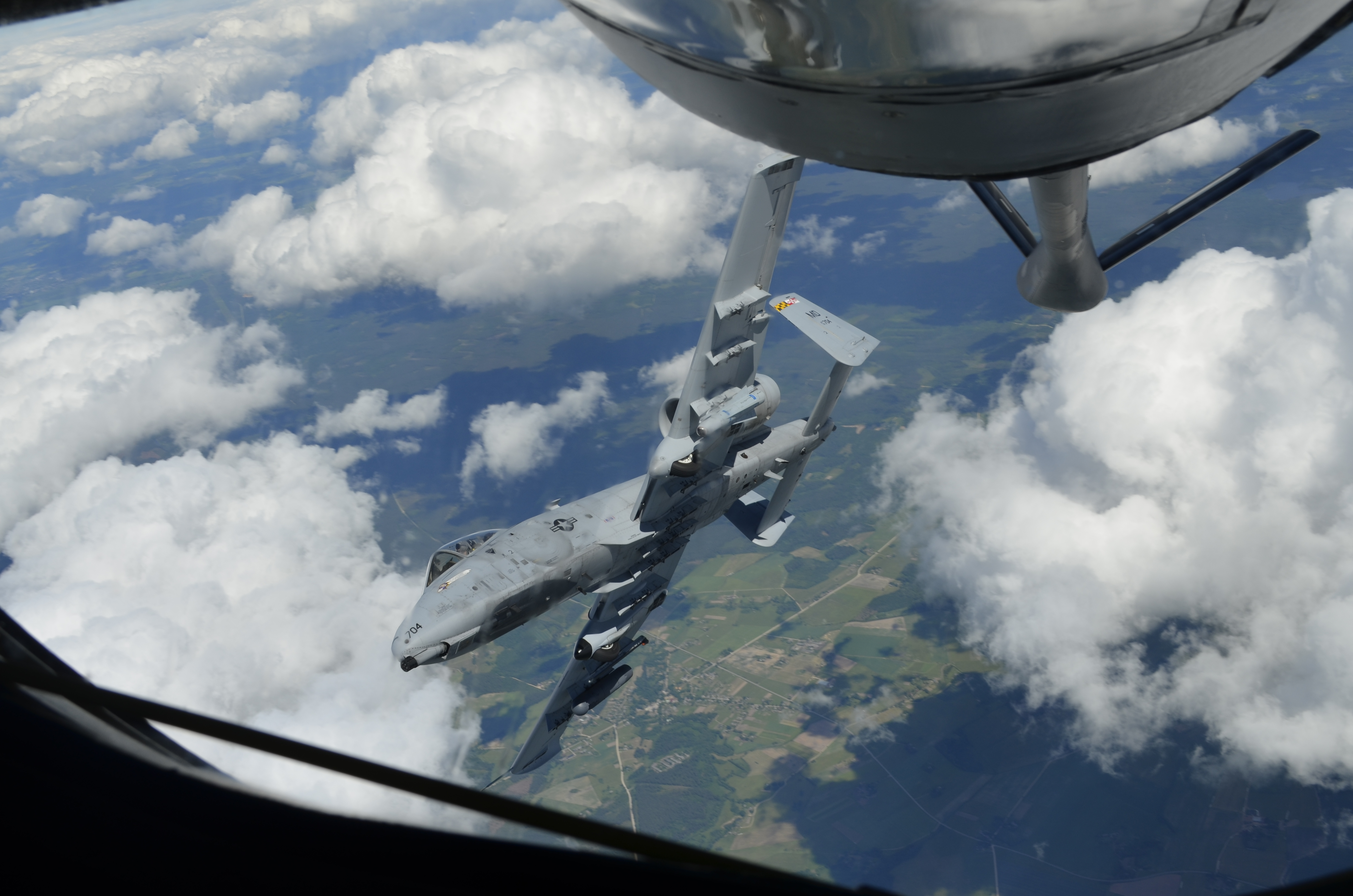 A Maryland Air National Guard A-10 Thunderbolt II peels off shortly after being refueled by Master Sgt. Joseph LaPinta, 171st Air Refueling Squadron boom operator, in a Michigan Air National Guard KC-135 Stratotanker during Saber Strike 2015. Exercise Saber Strike 2015 has brought 14 ally and partner nations together to increase interoperability between military forces. The Michigan National Guard is a part of a Department of Defense sponsored State Partnership Program between Michigan and the Latvian government, which began in 1993. (U.S. Air National Guard photo by Capt. Anthony J. Lesterson)