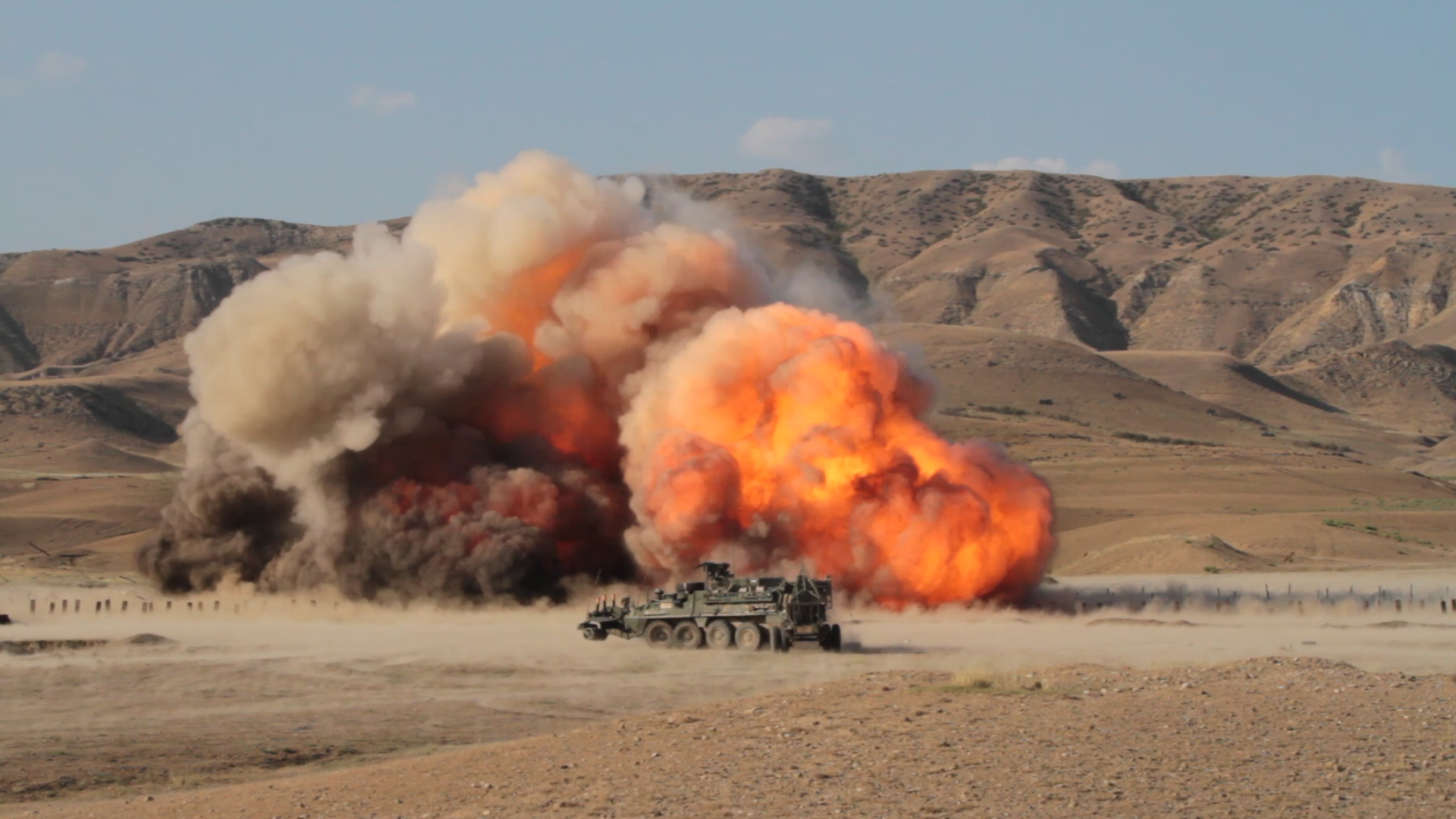 VAZIANI TRAINING AREA, Georgia — The Mine Clearing Line Charge (MICLIC) explodes in a Georgian obstacle during a rehearsal for the combined arms live fire, Vaziani Training Area, Georgia, Aug. 10, 2017. The live fire displays coordination between different assets and is a demonstration of combined capability. The live fire is the last training event before the closing of Exercise Noble Partner. Exercise Noble Partner is a multinational, U.S. Army Europe-led exercise conducting home station training for the Georgian light infantry company designated for the NATO Response Force. (U.S. Army photo by Sgt. Joshua Joyner)