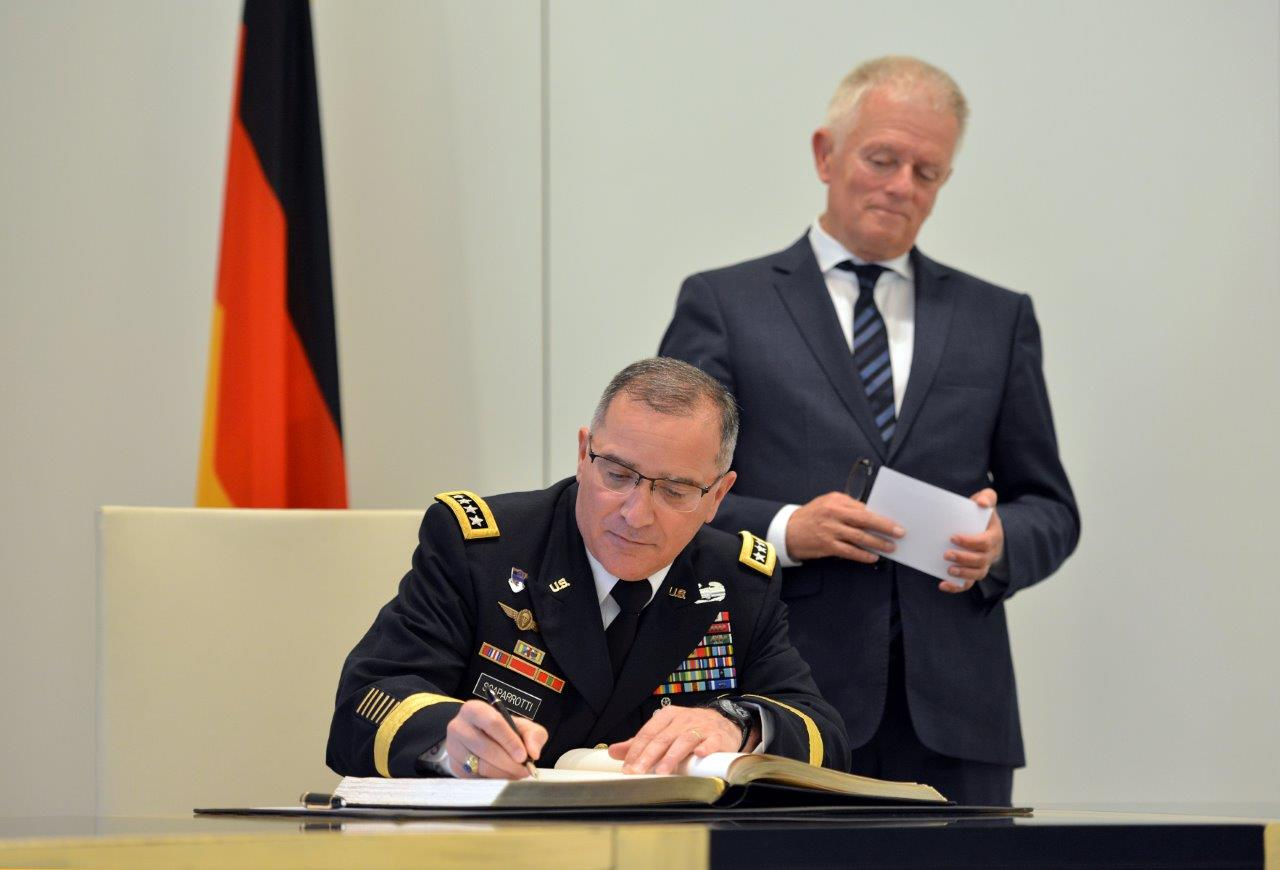 "GEN Scaparrotti met with Stuttgart Mayor Fritz Kuhn today at City Hall to enhance US relations with HQ EUCOM's host city.  In keeping with USEUCOM Commander tradition, he signed the guestbook, which city government refers to as the ""Golden Book,"" and personally thanked Mayor Kuhn for making Stuttgart home to service members and their families."