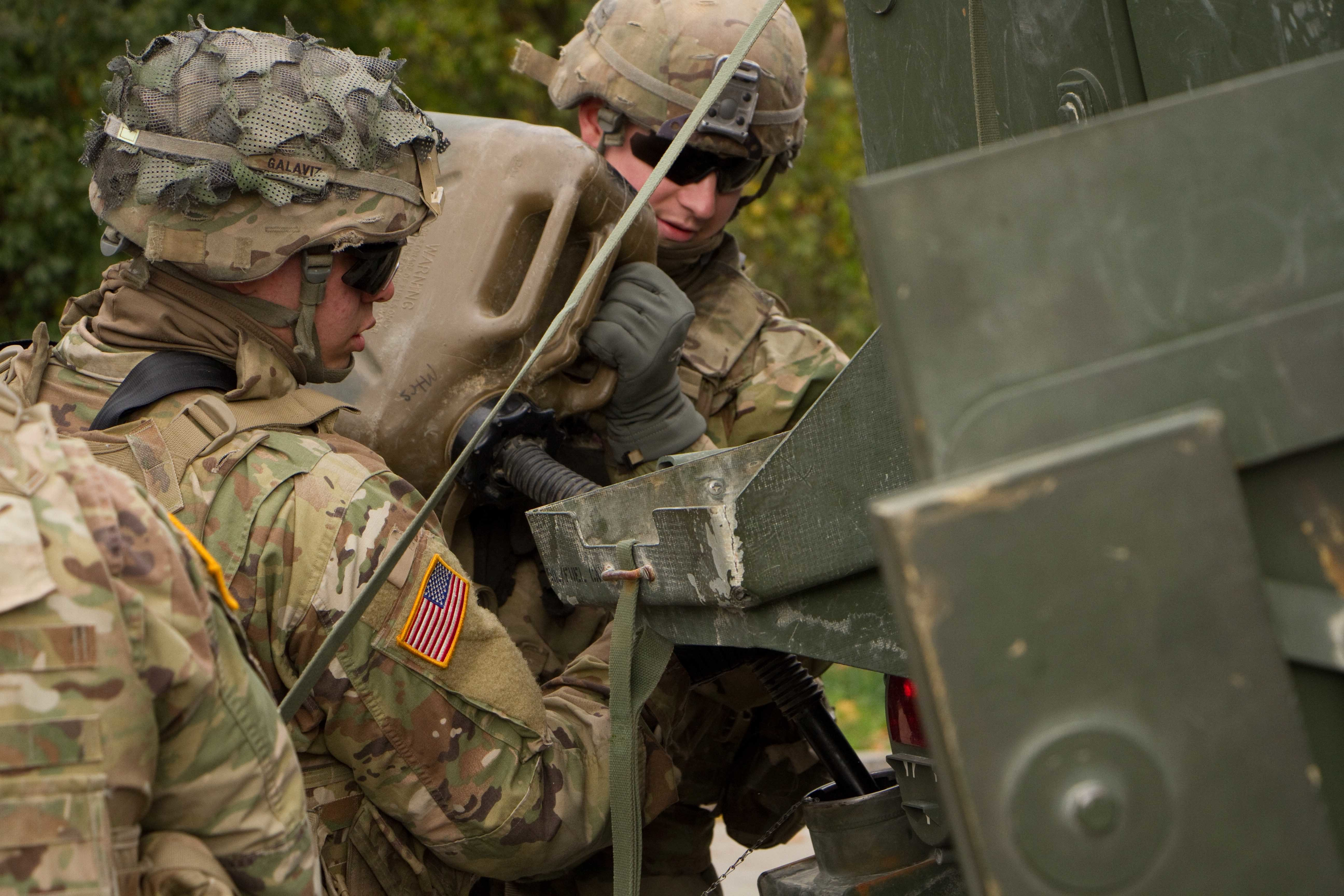 Soldiers assigned to 3d Squadron, 2d Cavalry Regiment, U.S. Army, refuel their Stryker Combat vehicle at a rest stop in Germany Oct. 11, 2017 during a 1,100 km road march from Rose Barracks, Germany to Orzysz, Poland. The Squadron with elements from Field Artillery Squadron, 2CR, the Regimental Engineer Squadron, 2CR and the Balaklava Squadron, Light Dragoons Regiment, British Army, are heading to Poland to be part of Battle Group Poland in support of NATO's enhanced Forward Presence initiative.
