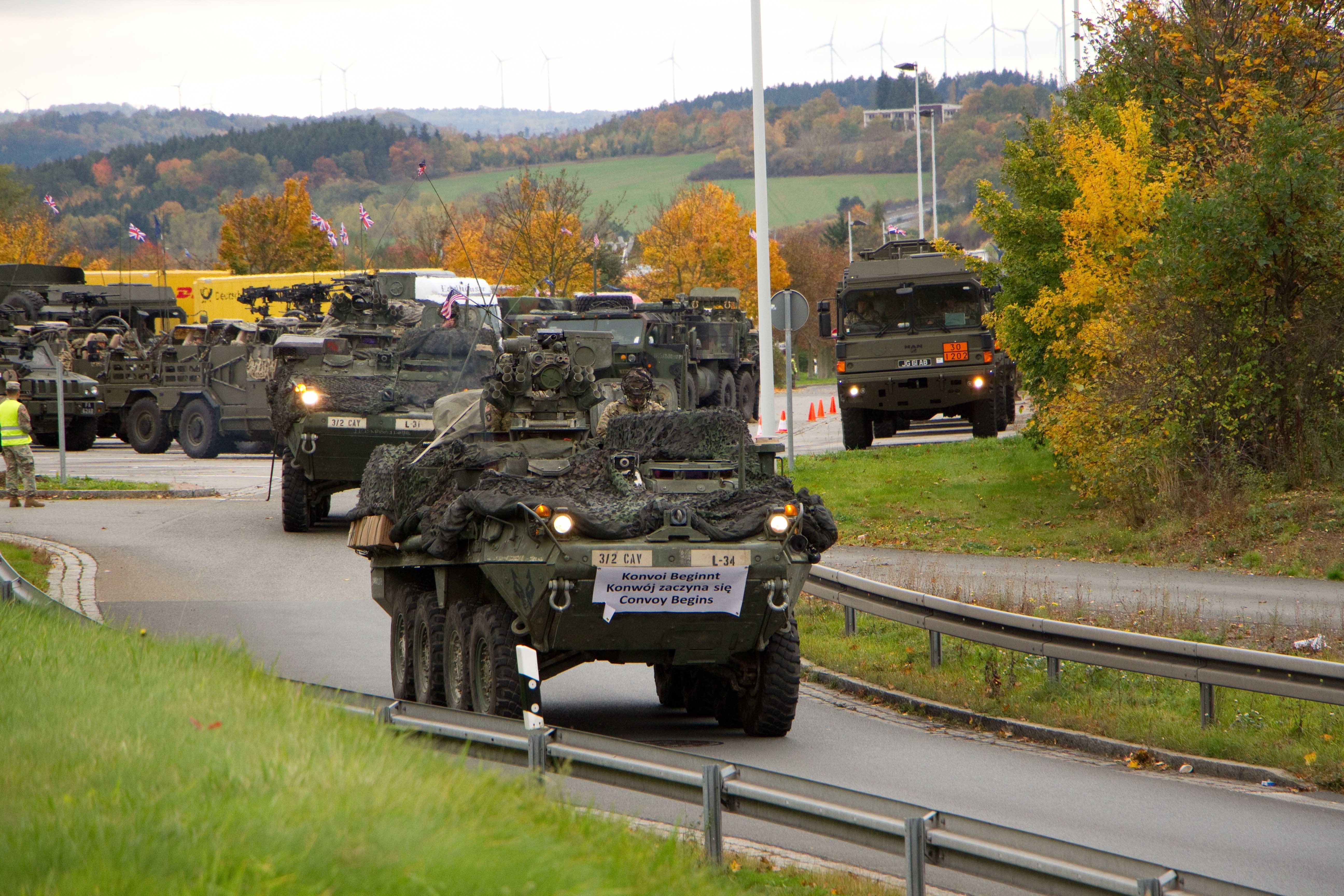 Task Force Wolfpack, comprised mainly of 3d Squadron, 2d Cavalry Regiment, U.S. Army with elements from Field Artillery Squadron, 2CR, the Regimental Engineer Squadron, 2CR and the Balaklava Squadron, Light Dragoons Regiment, British Army, leave a rest stop in Germany Oct. 11, 2017 during their 1,100 km road march from Rose Barracks, Germany to Orzysz, Poland. The Troops are heading to Poland to be part of Battle Group Poland in support of NATO's enhanced Forward Presence initiative.