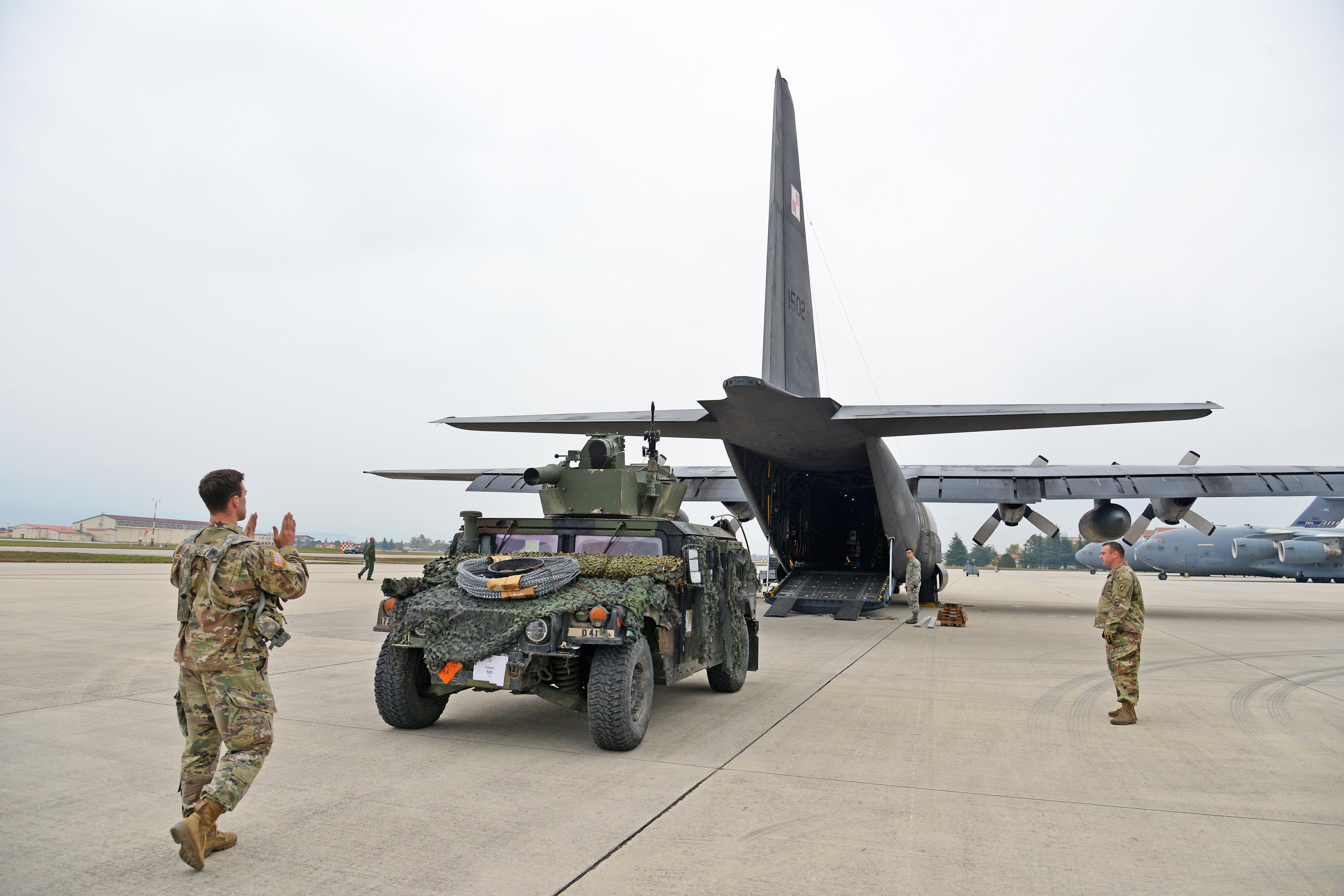 One High Mobility Multipurpose Wheeled Vehicle from 2nd Battalion, 503rd Infantry Regiment, 173rd Airborne Brigade, gets loaded into a Polish Air Force C-130 Hercules from 33rd ATB at Aviano Air Base, Italy, Oct. 11, 2017 during Exercise Swift Response 2017, Phase 2. Swift Response 2017 links to Exercise Saber Guardian 17, a U.S. Army Europe-led, multinational exercise that spans across Bulgaria, Hungary, and Romania with more than 25,000 service members from 22 allied and partner nations. (U.S. Army Photos by Visual Information Specialist Paolo Bovo/Released)
