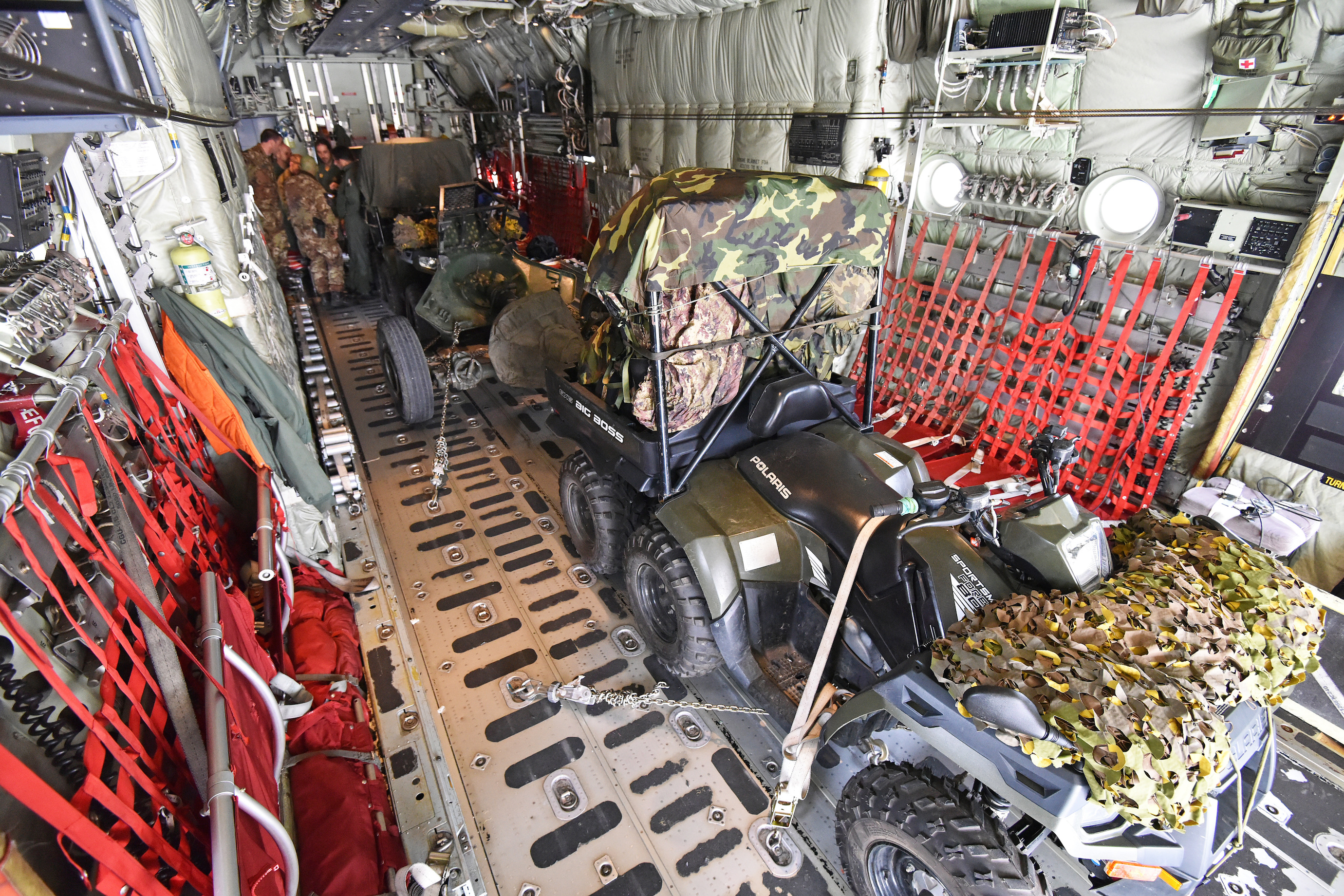 Two All Terrain Vehicles (ATVs) of the 185th Airborne Artillery Regiment, Folgore Brigade, are loaded into a Italian Air Force C-130 Hercules from 46th BA at Aviano Air Base, in Pordenone, Italy Oct. 11, 2017 during Exercise Swift Response 2017, Phase 2. Swift Response links to Exercise Saber Guardian 17, a U.S. Army Europe-led, multinational exercise that spans across Bulgaria, Hungary, and Romania with more than 25,000 service members from 22 allied and partner nations. (U.S. Army Photos by Visual Information Specialist Paolo Bovo/Released)