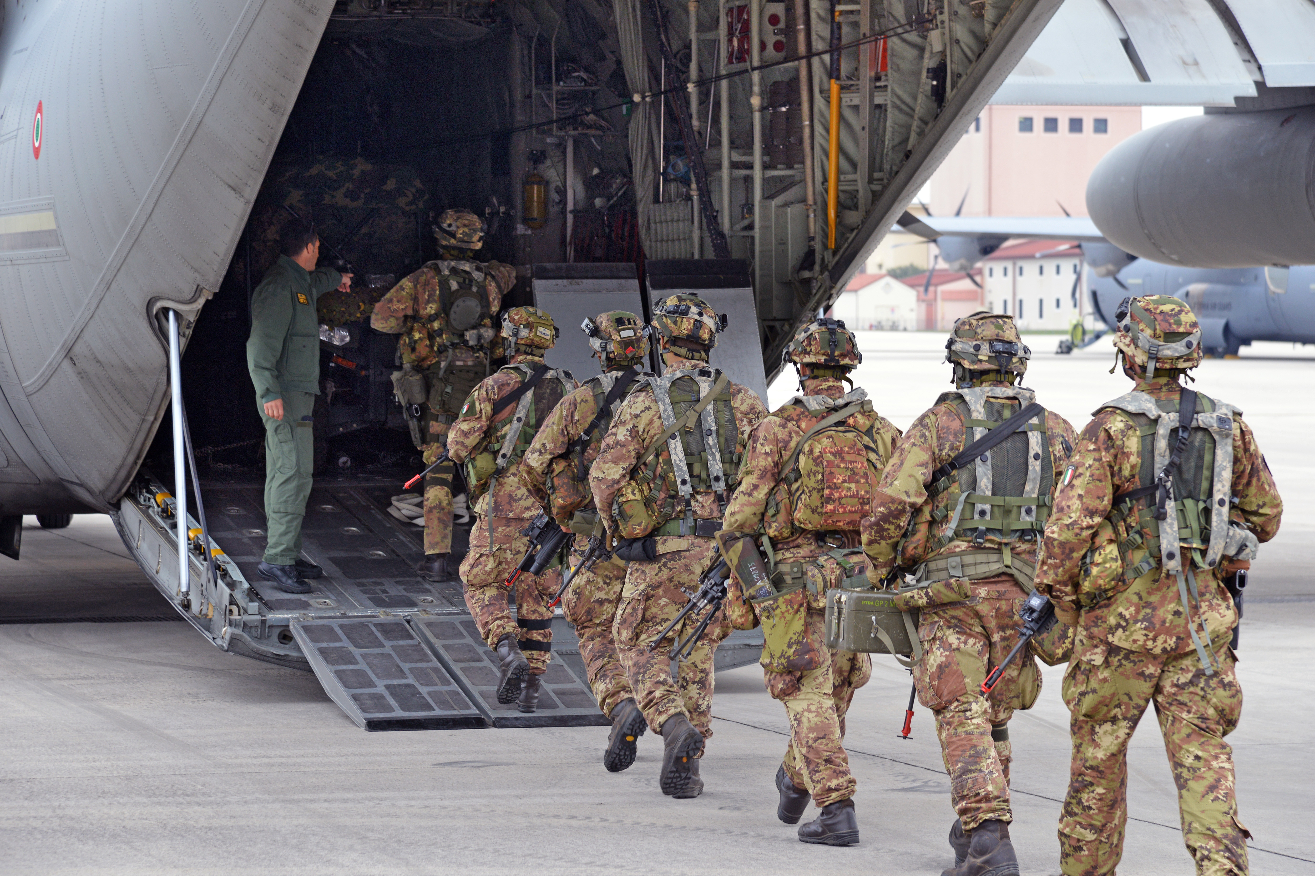 Paratroopers from the 185th Airborne Artillery Regiment, Folgore Brigade, board an Italian Air Force C-130 Hercules from 46th BA at Aviano Air Base, in Pordenone, Italy Oct. 11, 2017 during Exercise Swift Response 2017, Phase 2. Swift Response links to Exercise Saber Guardian 17, a U.S. Army Europe-led, multinational exercise that spans across Bulgaria, Hungary, and Romania with more than 25,000 service members from 22 allied and partner nations. (U.S. Army Photos by Visual Information Specialist Paolo Bovo/Released)