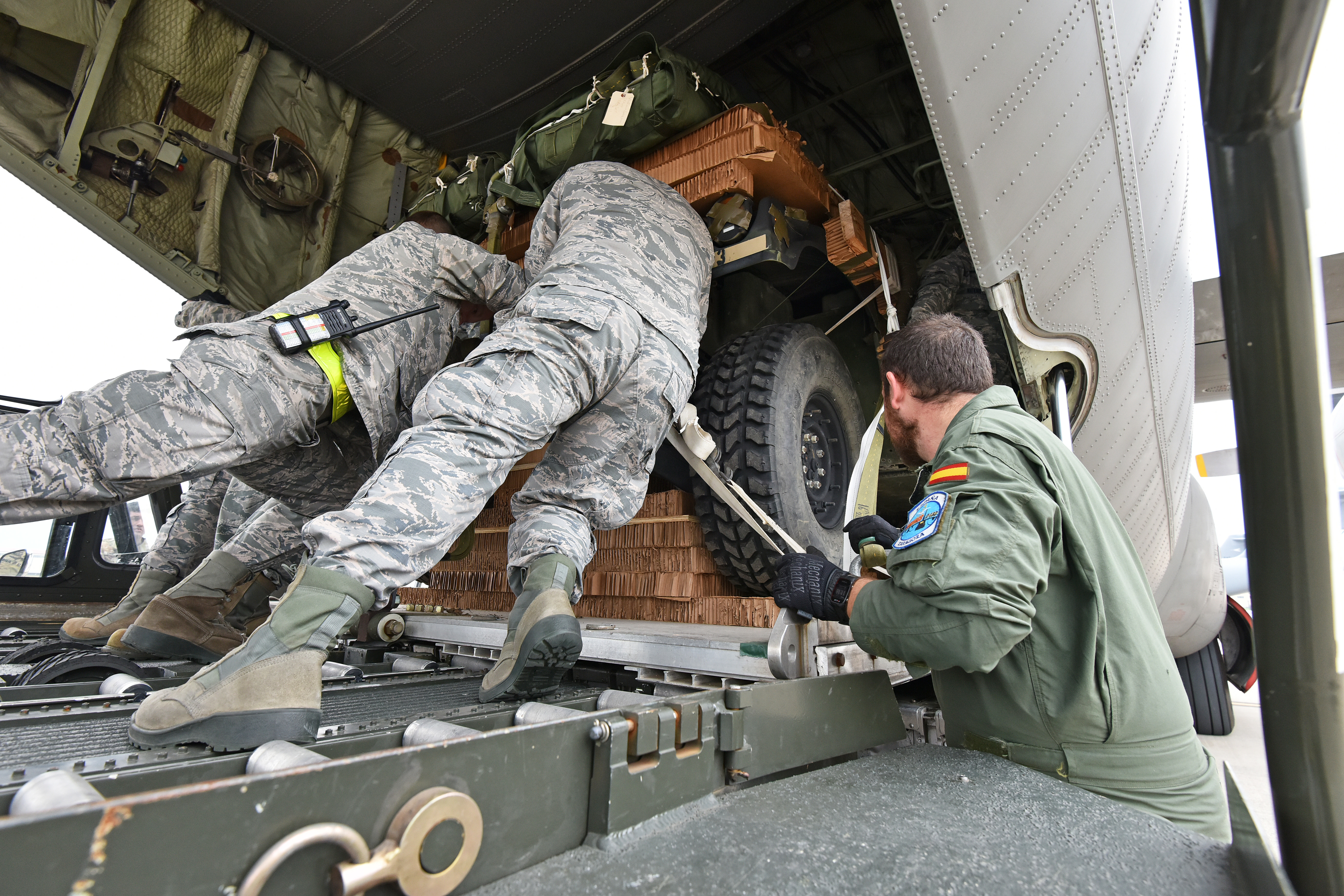 Two High Mobility Multipurpose Wheeled Vehicles from 2nd Battalion, 503rd Infantry Regiment, 173rd Airborne Brigade are loaded into a Spanish Air Force C-130 Hercules from ALA 31st at Aviano Air Base, Italy, Oct. 11, 2017 during Exercise Swift Response 2017, Phase 2. Swift Response links to Exercise Saber Guardian 17, a U.S. Army Europe-led, multinational exercise that spans across Bulgaria, Hungary, and Romania with more than 25,000 service members from 22 allied and partner nations. (U.S. Army Photos by Visual Information Specialist Paolo Bovo/Released)