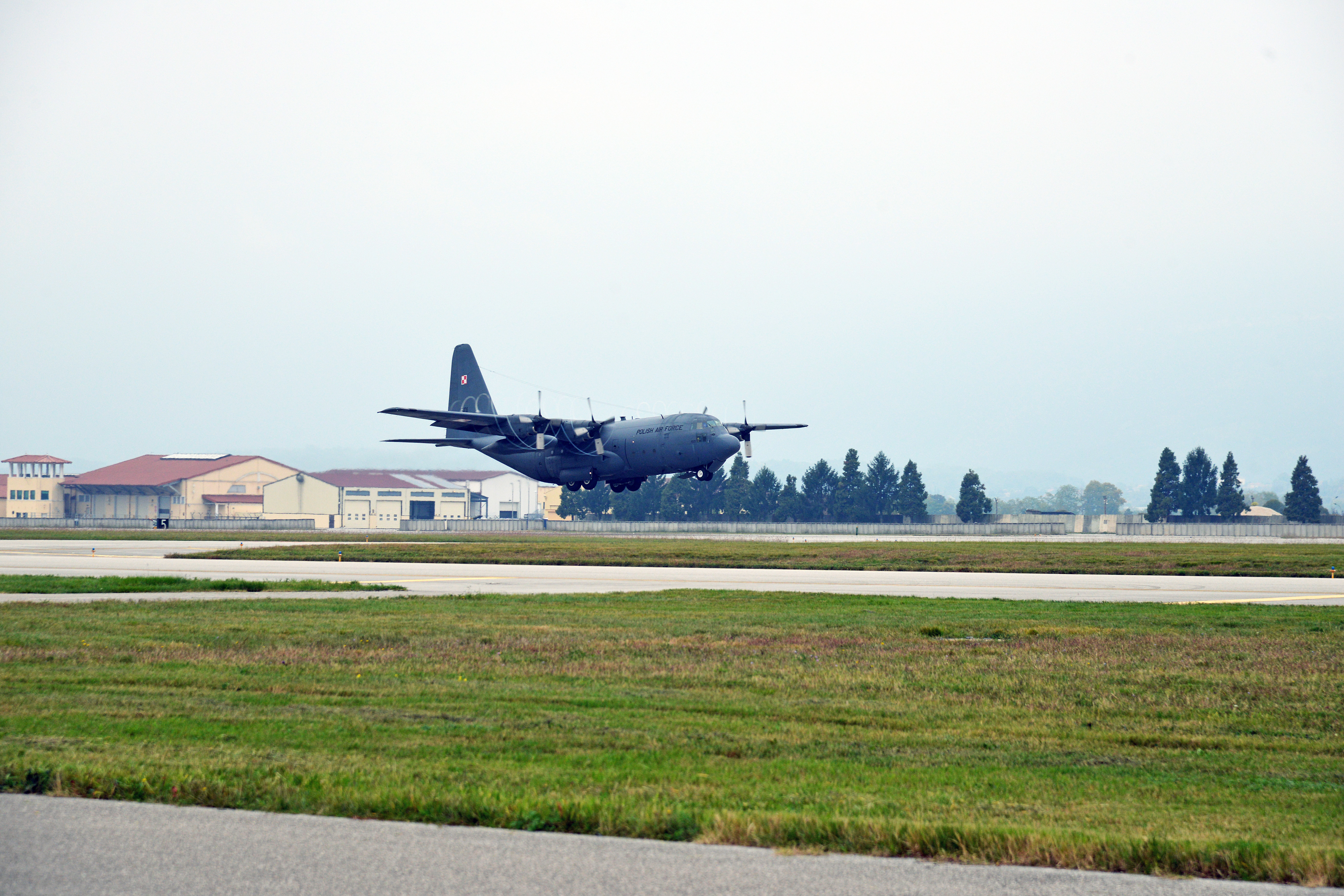 A Polish Air Force C-130 Hercules from the 33rd ATB, takes off from Aviano Air Base, in Pordenone, Italy Oct. 11, 2017 during Exercise Swift Response 2017, Phase 2. Swift Response links to Exercise Saber Guardian 17, a U.S. Army Europe-led, multinational exercise that spans across Bulgaria, Hungary, and Romania with more than 25,000 service members from 22 allied and partner nations. (U.S. Army Photos by Visual Information Specialist Paolo Bovo/Released)