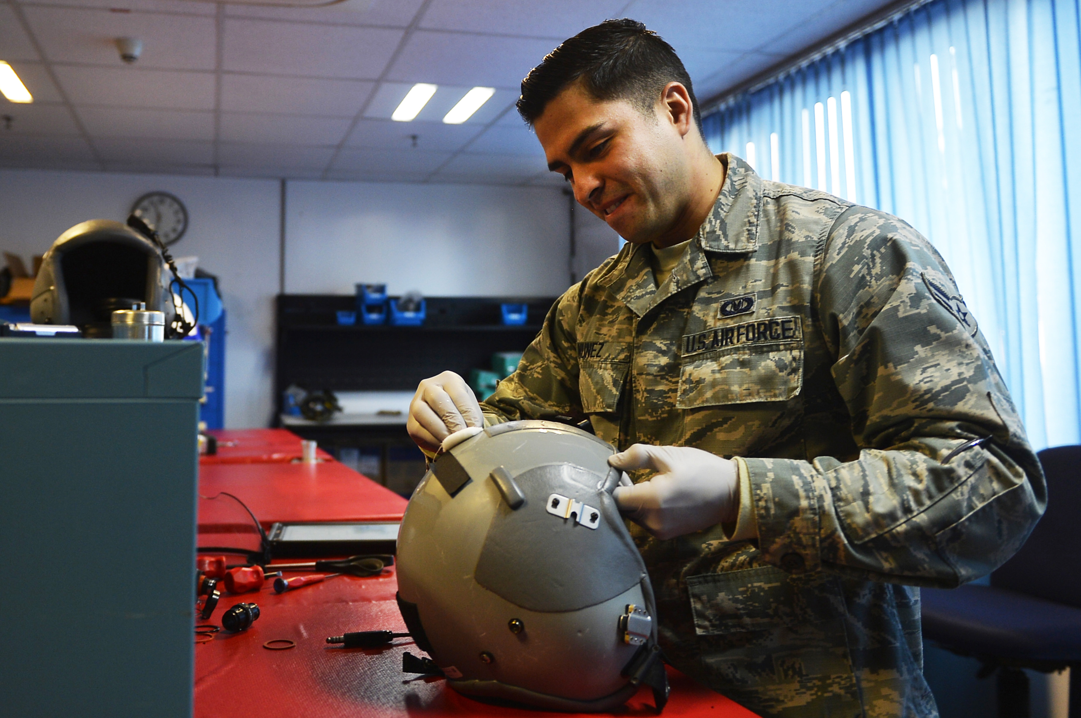 U.S. Air Force Airman 1st Class Manuel Nunez, 86th Operations Support Squadron aircrew flight equipment technician, cleans a helmet on Ramstein Air Base, Germany, Oct. 17, 2017. Airmen in AFE are responsible for inspecting, maintaining, and keeping accountability of various kinds of equipment used by aircrew. (U.S. Air Force photo by Airman 1st Class Joshua Magbanua)